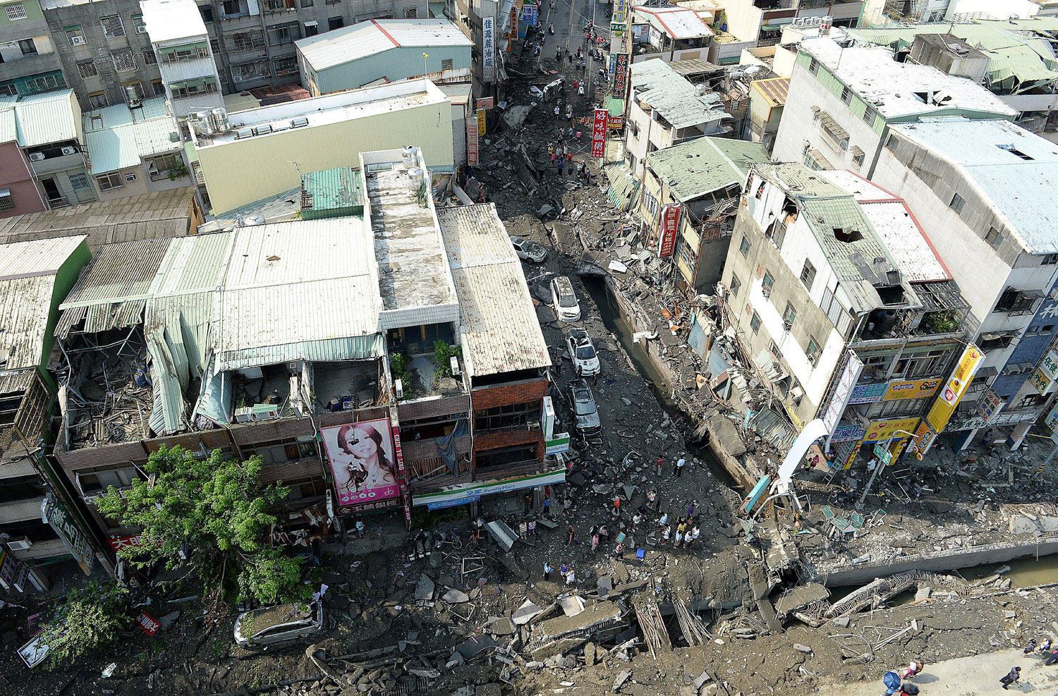 Destroyed roads and buildings after a gas leak explosions in Kaohsiung, southeast China's Taiwan on Aug. 1, 2014