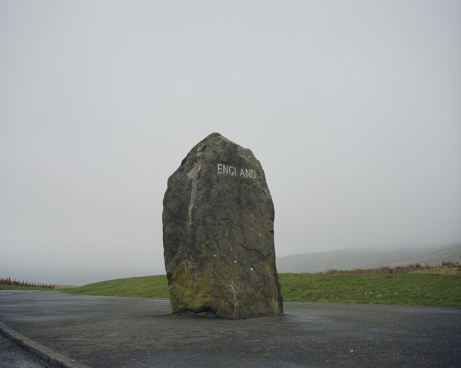 A large stone marking the English side of the border with Scotland on the A68 between Jedburgh, Scotland and Newcastle, England.