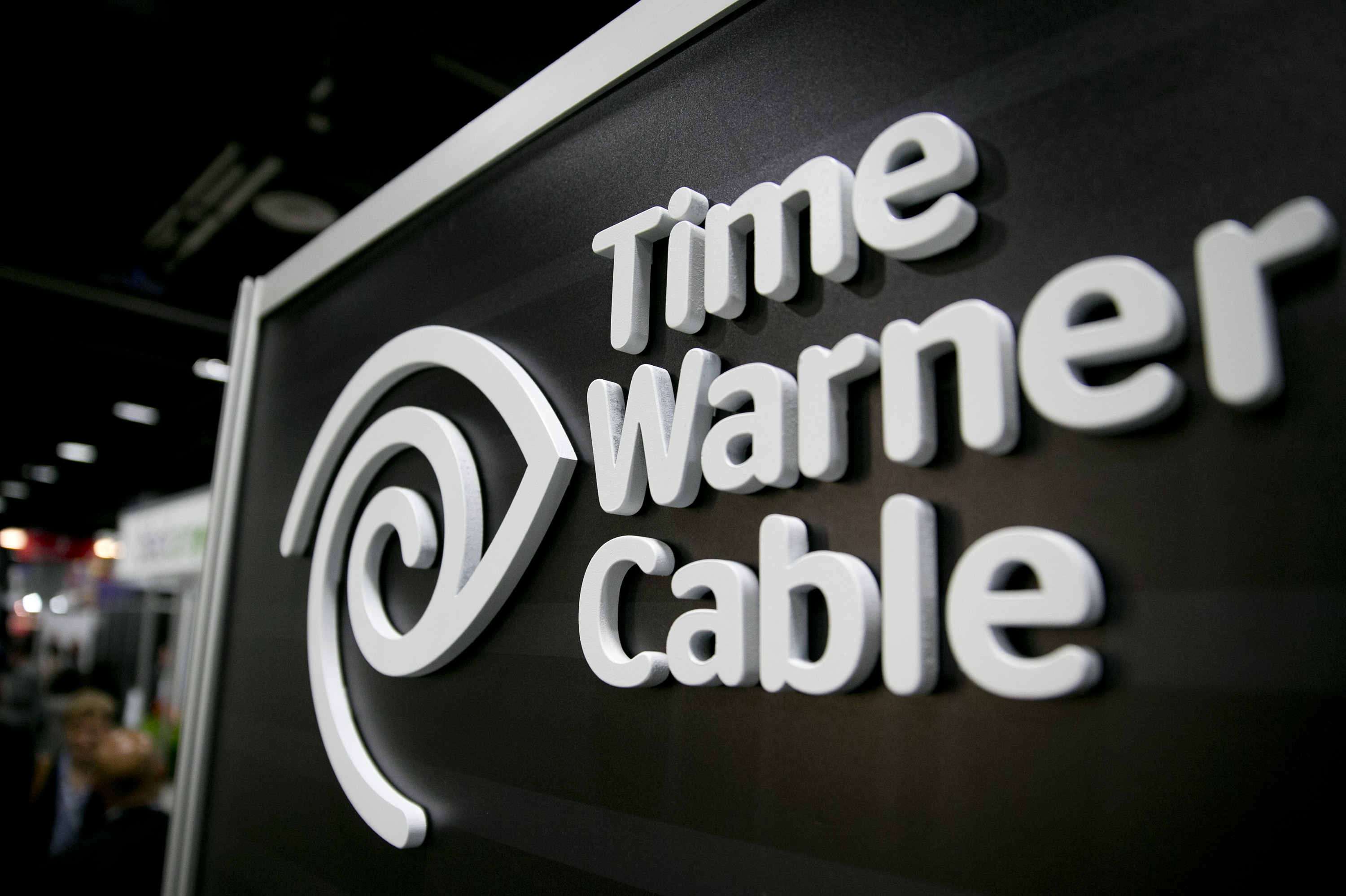 The Time Warner Cable Inc. logo is seen on the exhibit floor during the National Cable and Telecommunications Association (NCTA) Cable Show in Washington, D.C., U.S., on Tuesday, June 11, 2013.