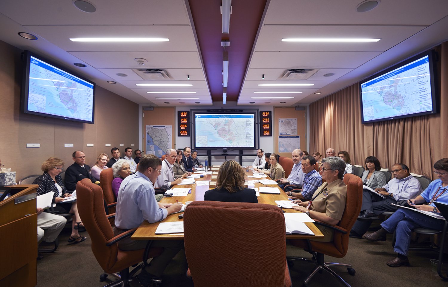 CDC leaders integral to the Ebola response, including epidemiologists, laboratorians, logistics, and more, assemble in agency's command center to discuss next steps in directing the response at CDC Emergency operations center in Atlanta, August 8.