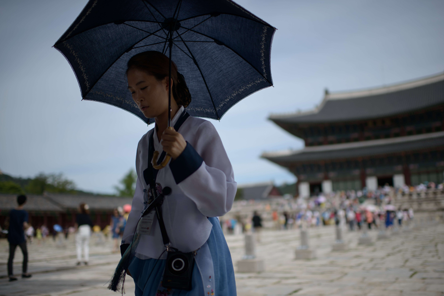 Aug. 27, 2014. A South Korean tour guide walks before the Gyeongbokgung Palace in Seoul.