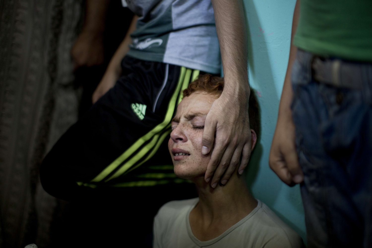 Aug. 21, 2014. A relative of senior Hamas commander Raed al-Atar, one of three senior Hamas commanders killed in an Israeli military strike, mourns during his funeral in the southern Gaza Strip town of Rafah.