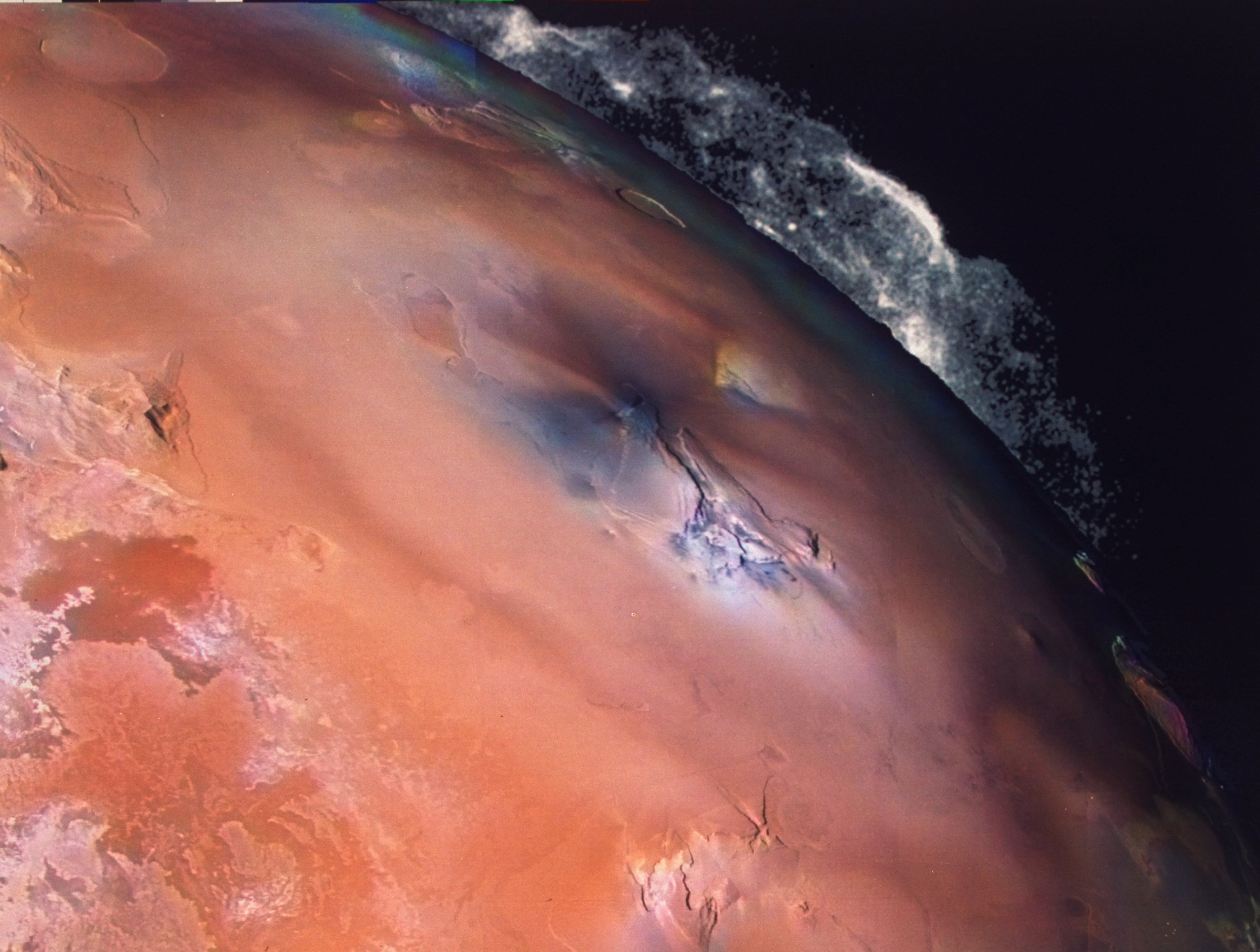 View of volcanic eruptions of Pele on Jupiter's moon Io taken from the Voyager 2 spacecraft.