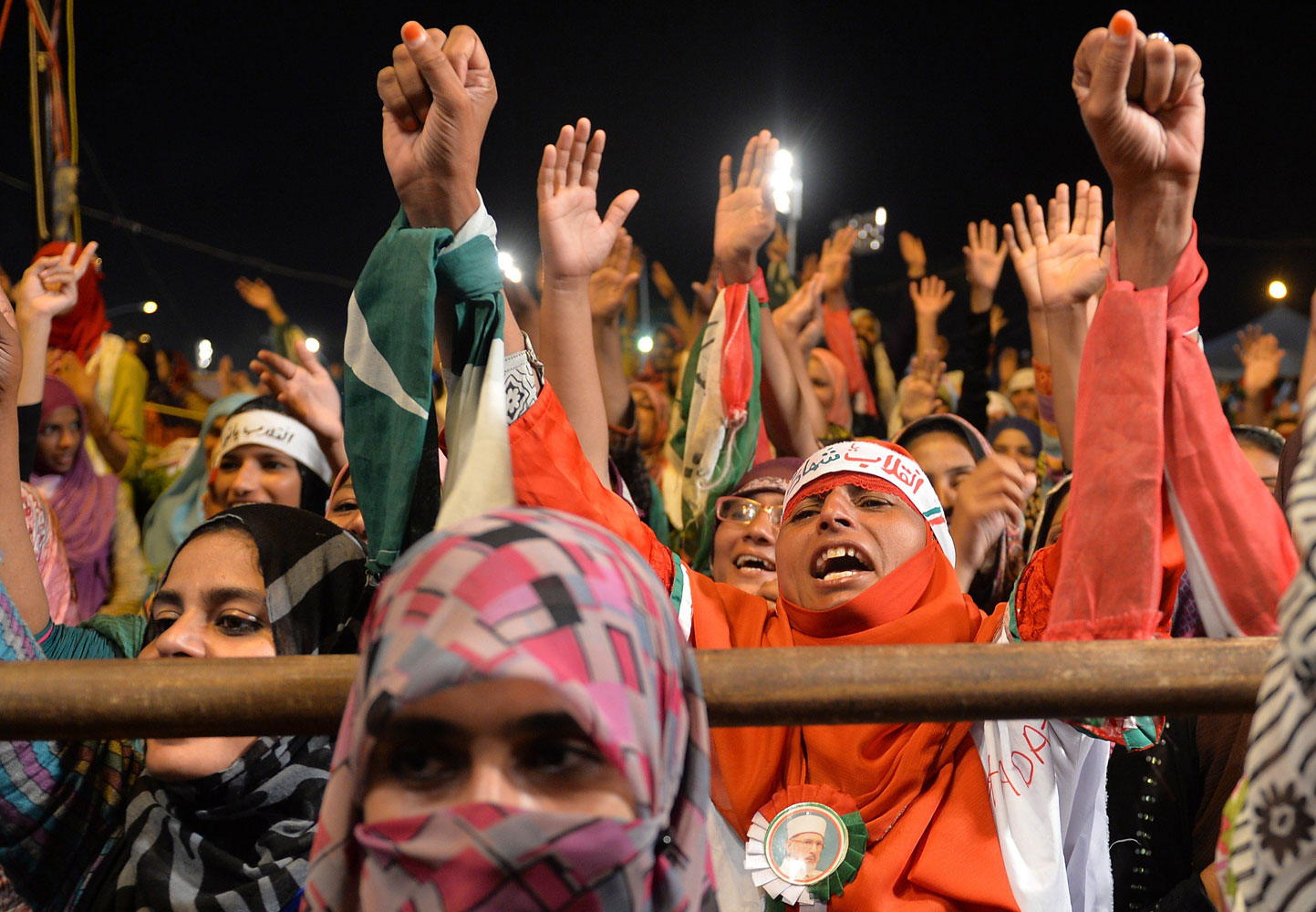 Pakistani supporters of Canada-based preacher Tahir-ul-Qadri shout anti-government slogans during a protest in front of the Parliament in Islamabad on Aug. 29, 2014.