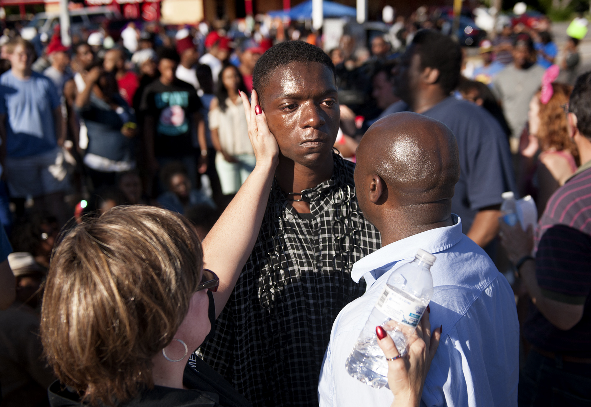 The Rev. Willis Johnson (right) talks to 18-year-old Joshua Wilson as protesters defy police and block traffic on West Florissant Avenue at Canfield Drive in Ferguson, Mo. on Aug. 13, 2014.