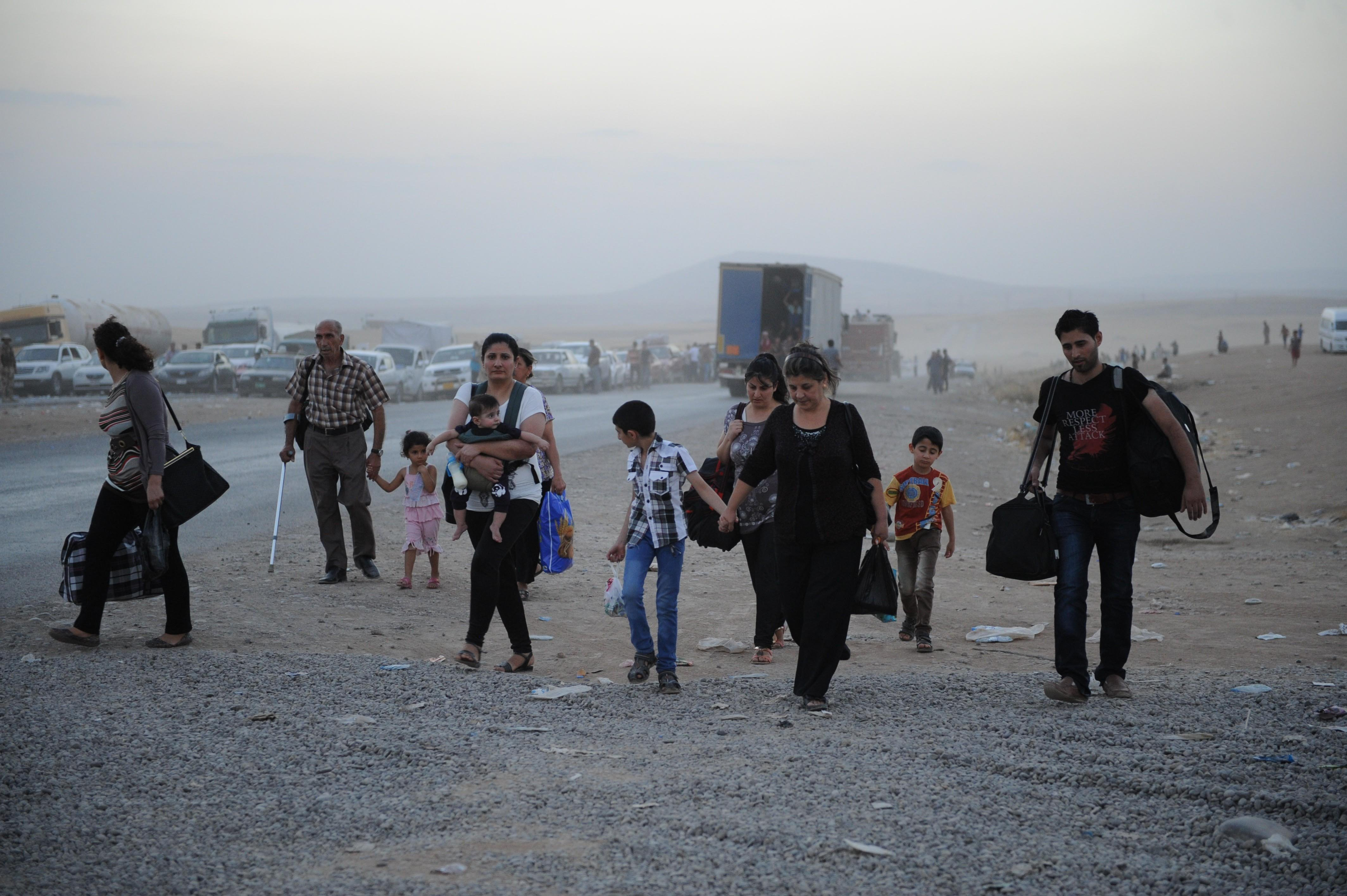 Thousands of Yazidi and Christian people flee Hamdaniyah town of Mosul to Erbil after the latest wave of ISIL advances that began on Sunday has seen a number of towns near Iraq's second largest city Mosul fall to the militants on August 6, 2014.