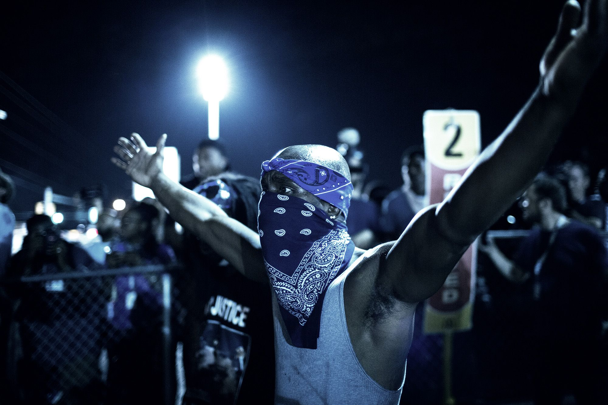 A protestor demonstrates in Ferguson, Mo. on Aug. 19, 2014.