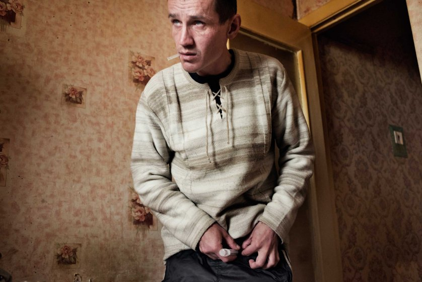The following photographs were taken in Yekaterinburg, Russia in 2013.Alexei, age 33, injects a dose of krokodil. Because of his dependence on krokodil, Alexei has injuries and swelling around his feet and is forced to walk with a cane.