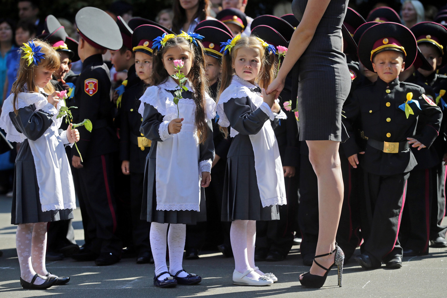 Sept. 1, 2014. Ukrainian girls from cadet's lyceum attend a first day of school, which marks the traditional start of the academic year in Kiev, Ukraine.