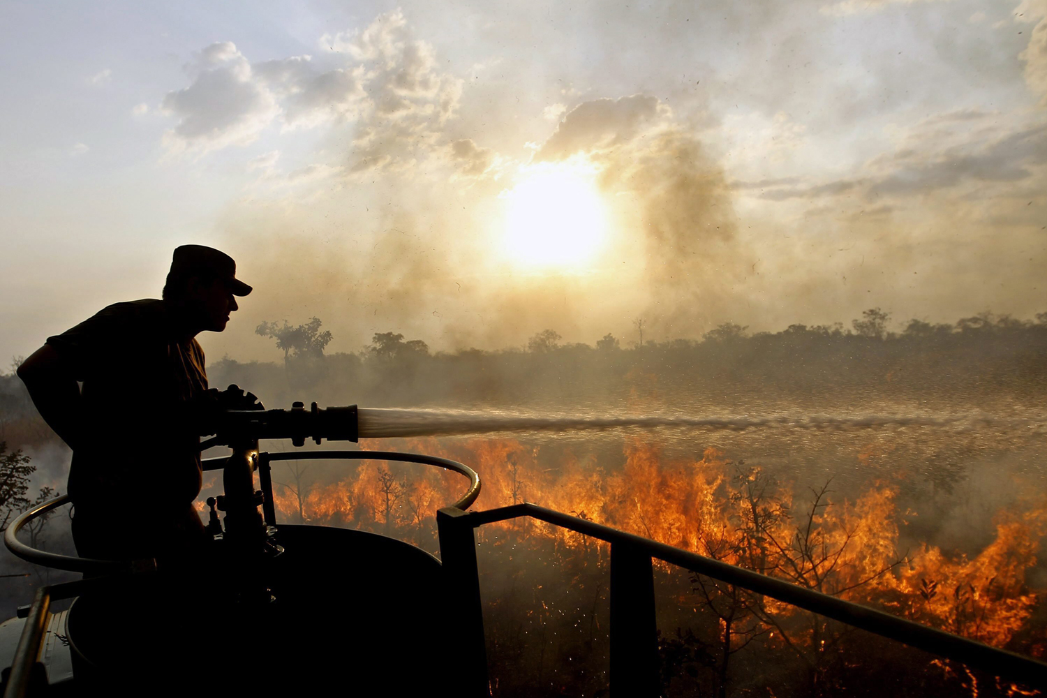 Sept. 1, 2014. An army soldier tries to extinguish a fire at the park Floresta Nacional in Brasilia, Brazil. Six teams, a helicopter and an aircraft were mobilized to contain the fire. The Brazilian capital suffers of current low humidity and a period of drought.