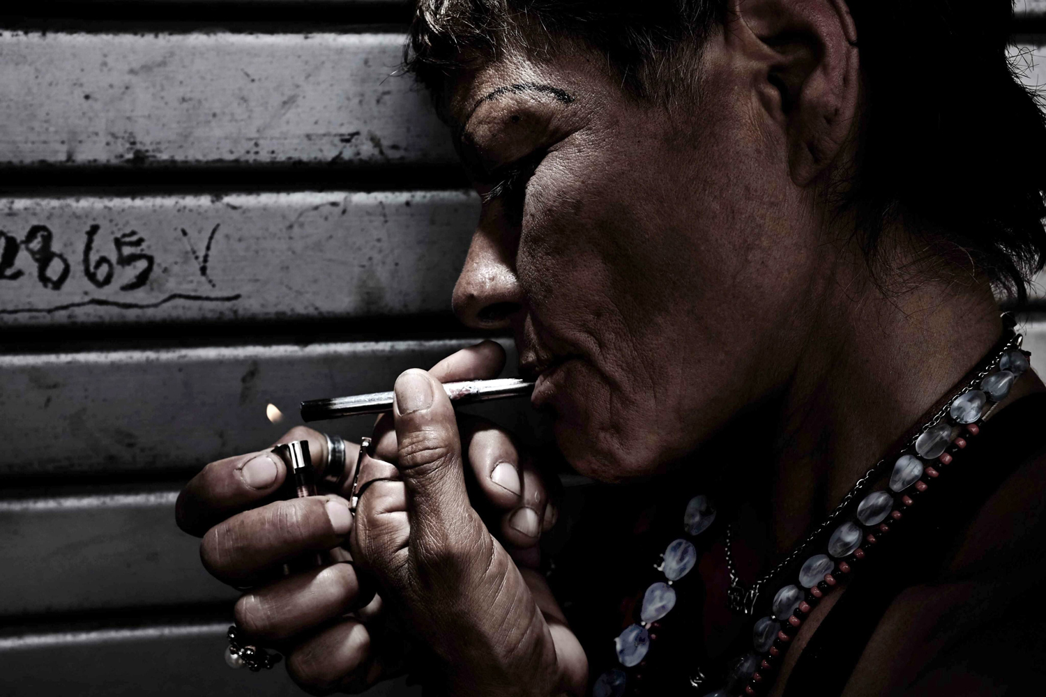 Sept. 3, 2014. A drug addict smokes drugs at a shanty town in the city of San Jose, Costa Rica.