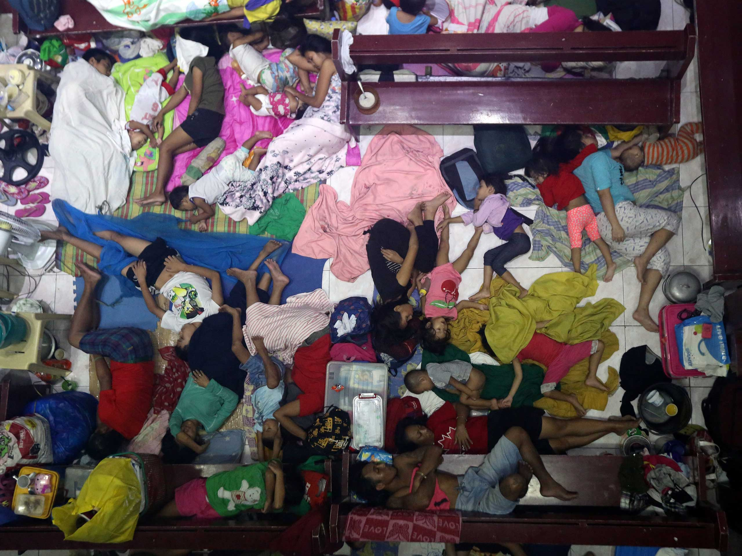Sept. 20, 2014. Filipino flood victims rest inside a church turned into a temporary evacuation center in Marikina city, east of Manila, Philippines.