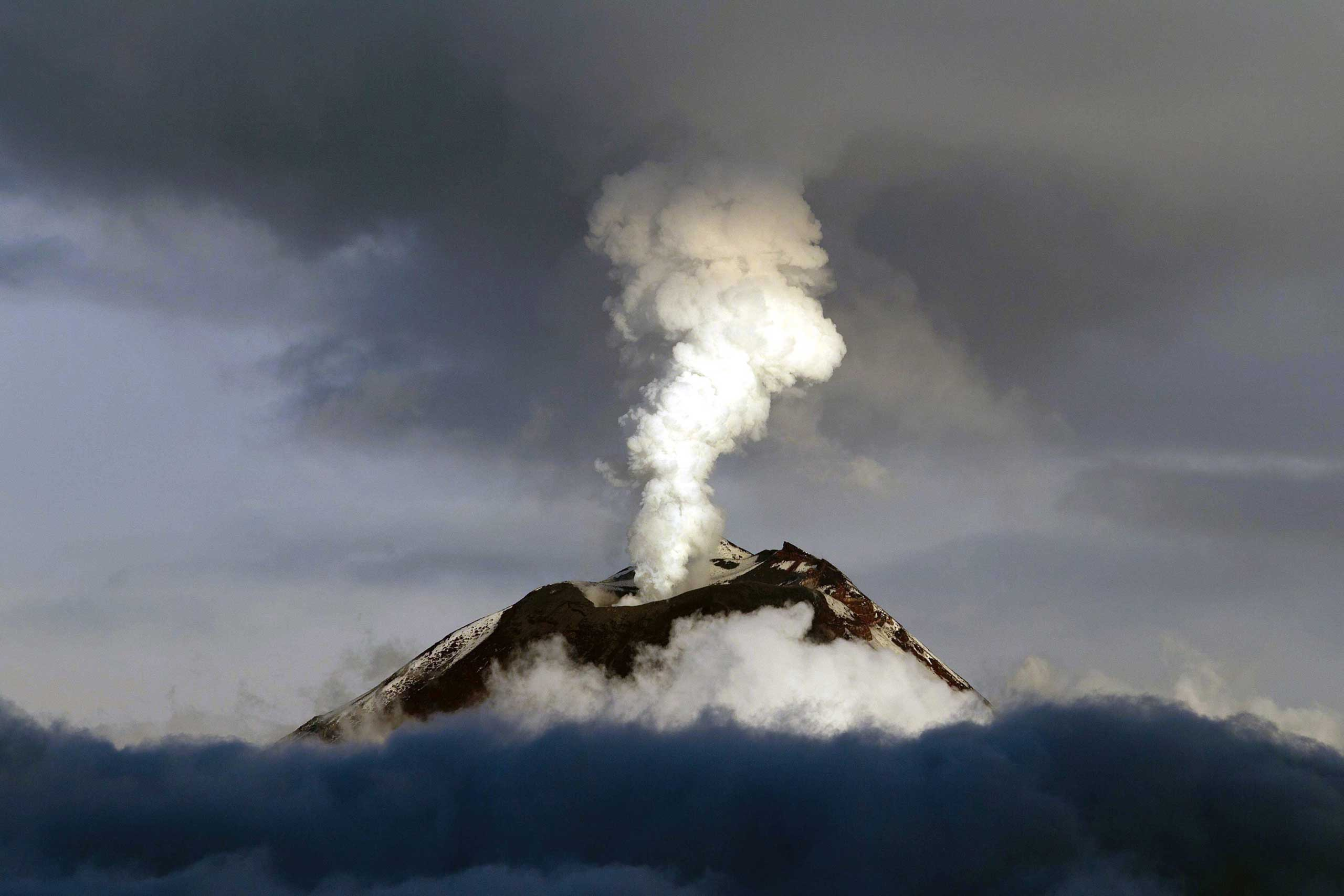Sept. 19, 2014. Tungurahua volcano seen is seen from the town of Mocha, Ecuador.