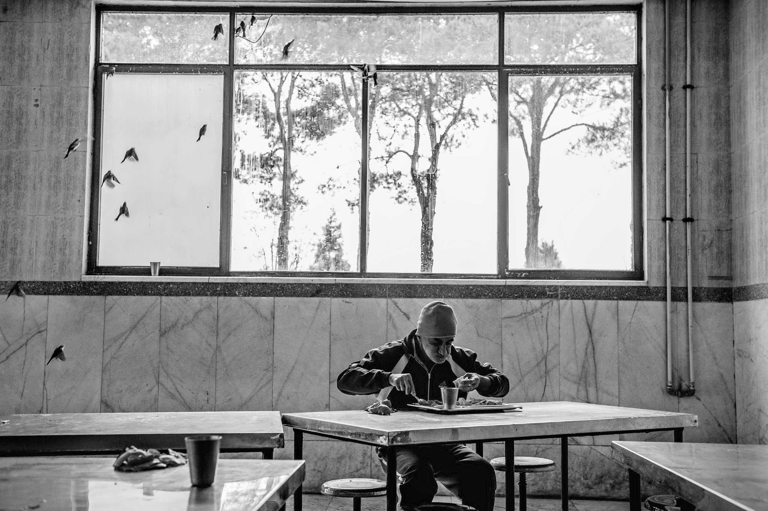 A man eats lunch.