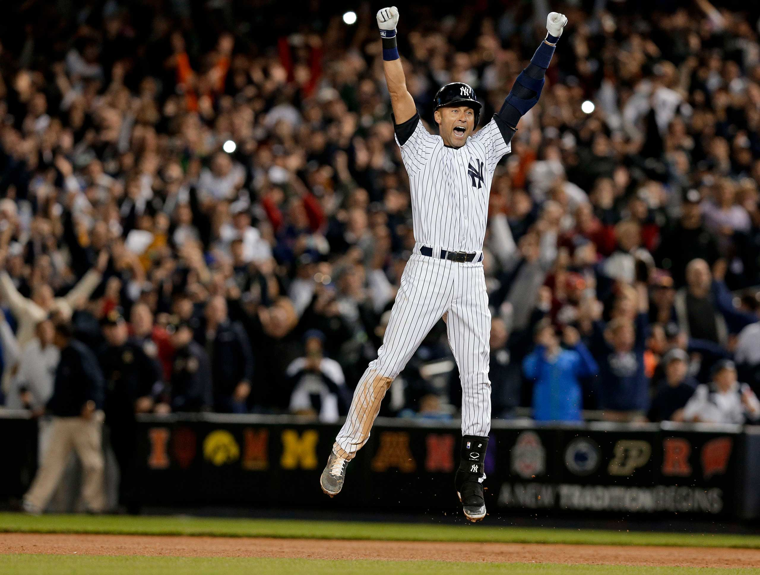 Sept. 25, 2014. New York Yankees' Derek Jeter jumps after hitting the game-winning single against the Baltimore Orioles in the ninth inning of a baseball game in New York.