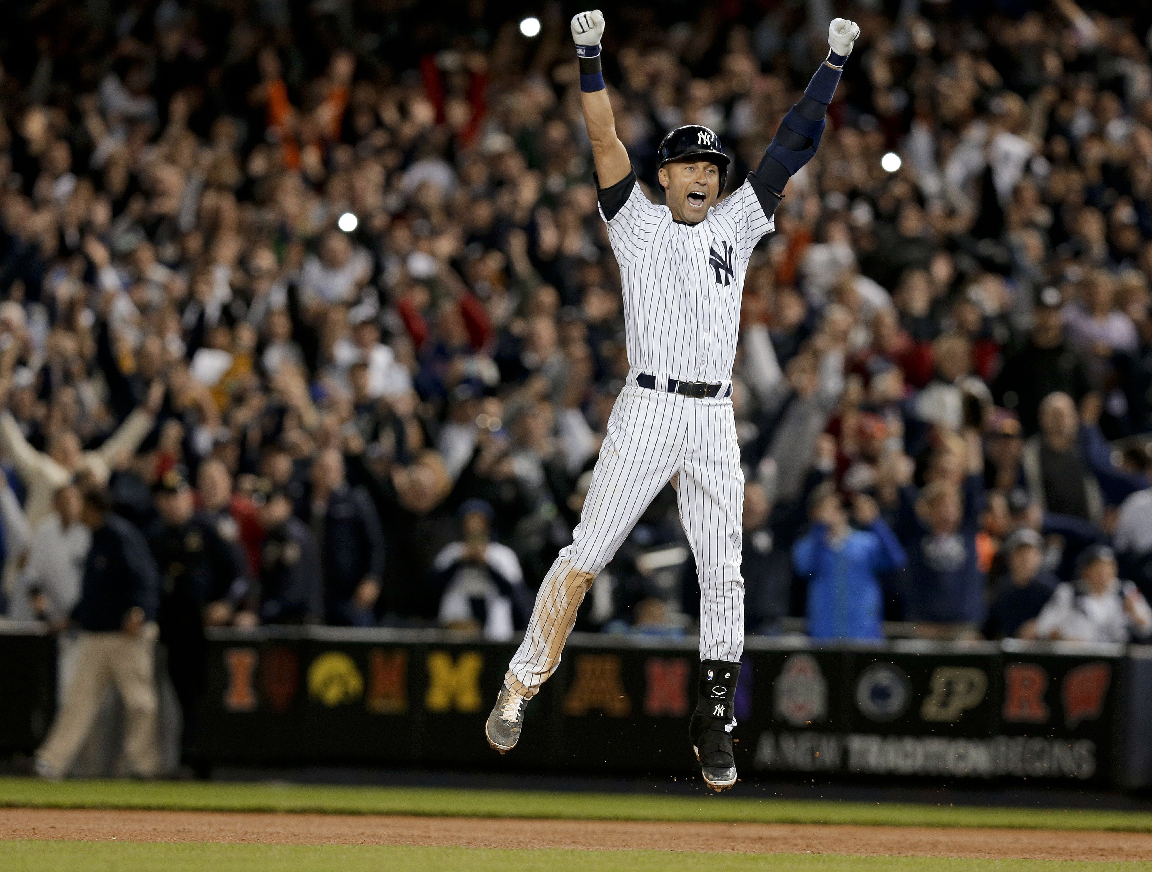 New York Yankees' Derek Jeter jumps after hitting the game-winning single against the Baltimore Orioles in the ninth inning of a baseball game, Sept. 25, 2014, in New York.
