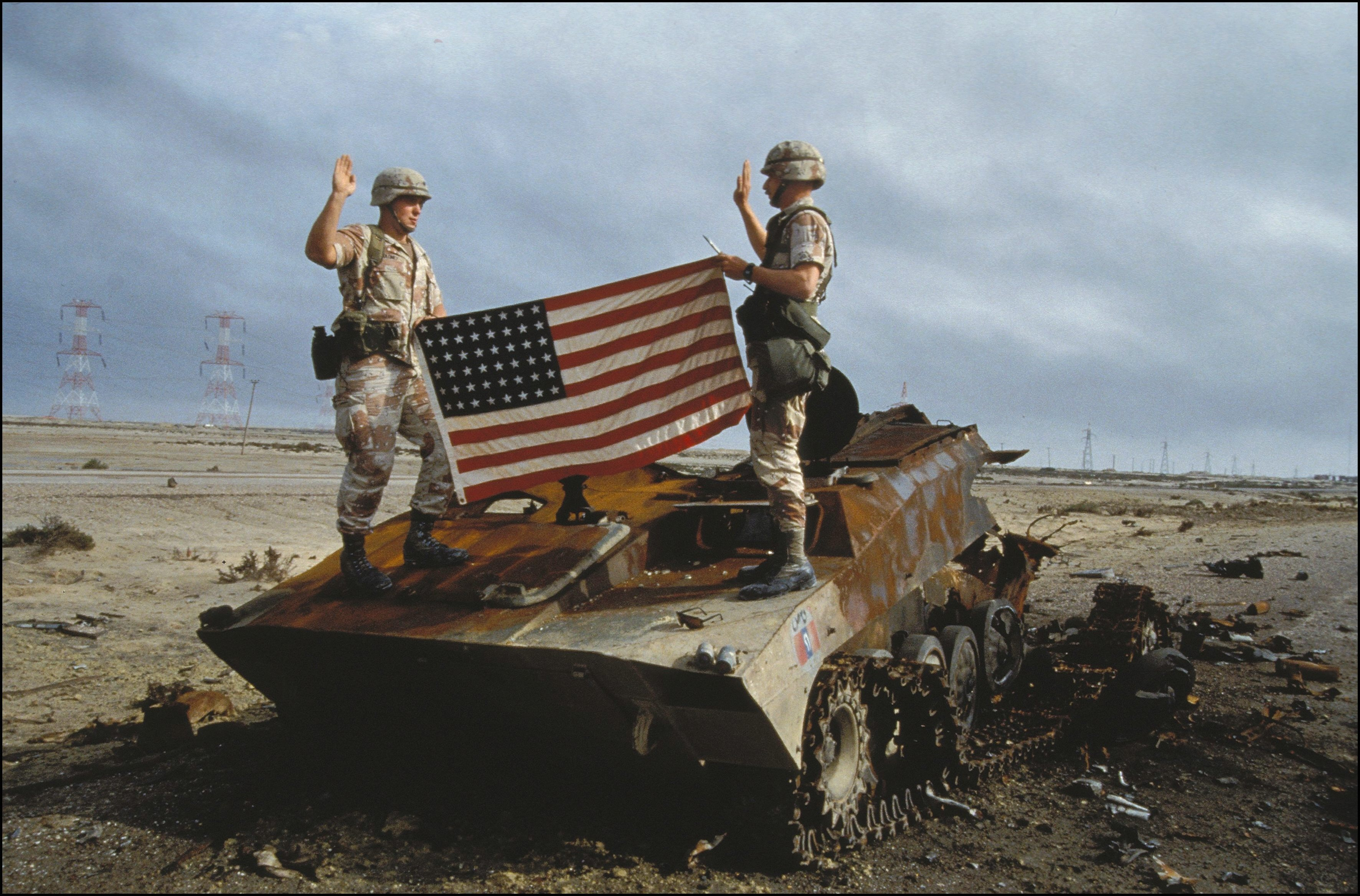 US soldiers take oath to the US army on an Iraqi destroyed tank in Iraq on February 27th, 1991.