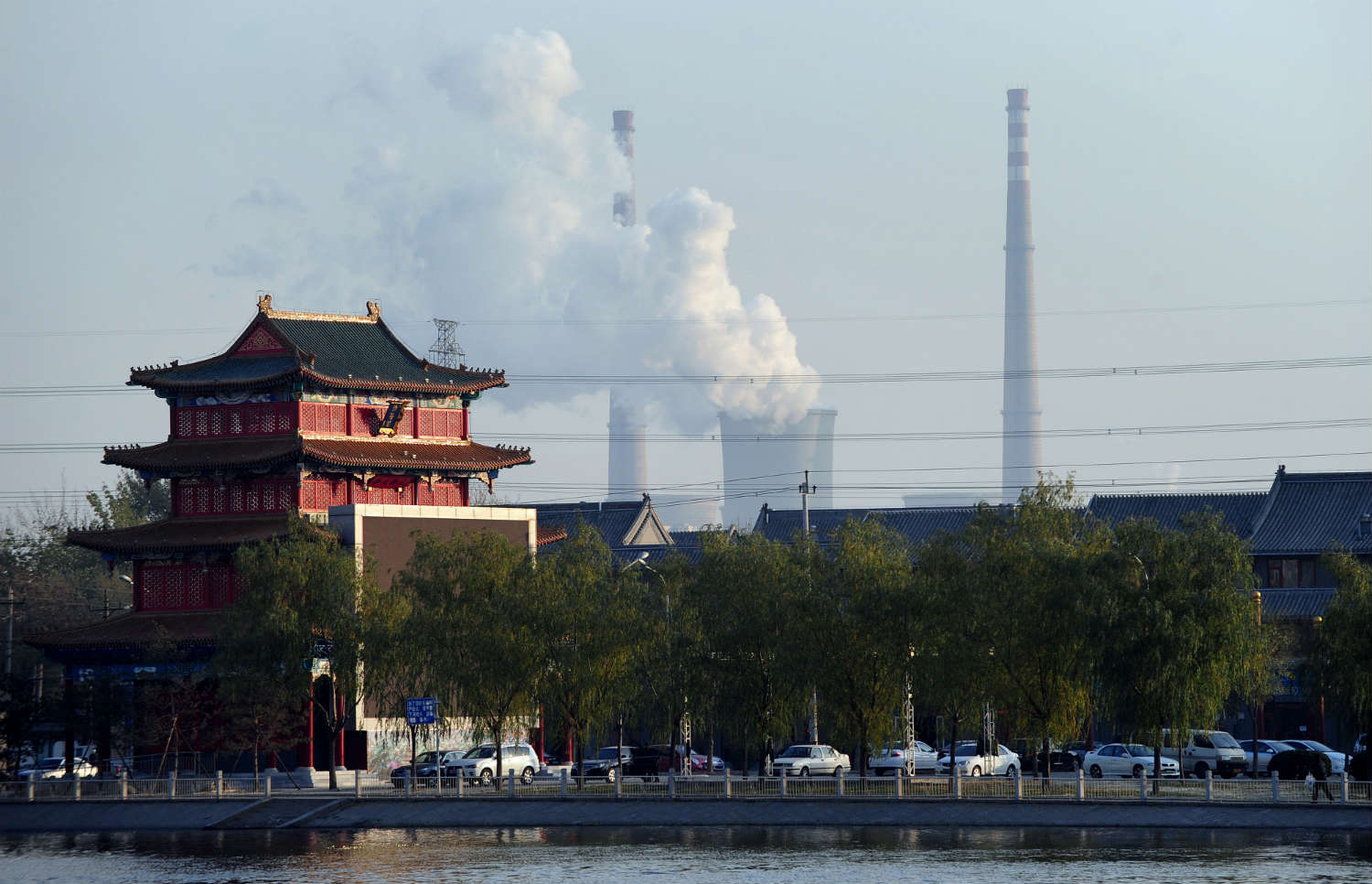 A coal plant looms behind a traditional house in Tianjin, China