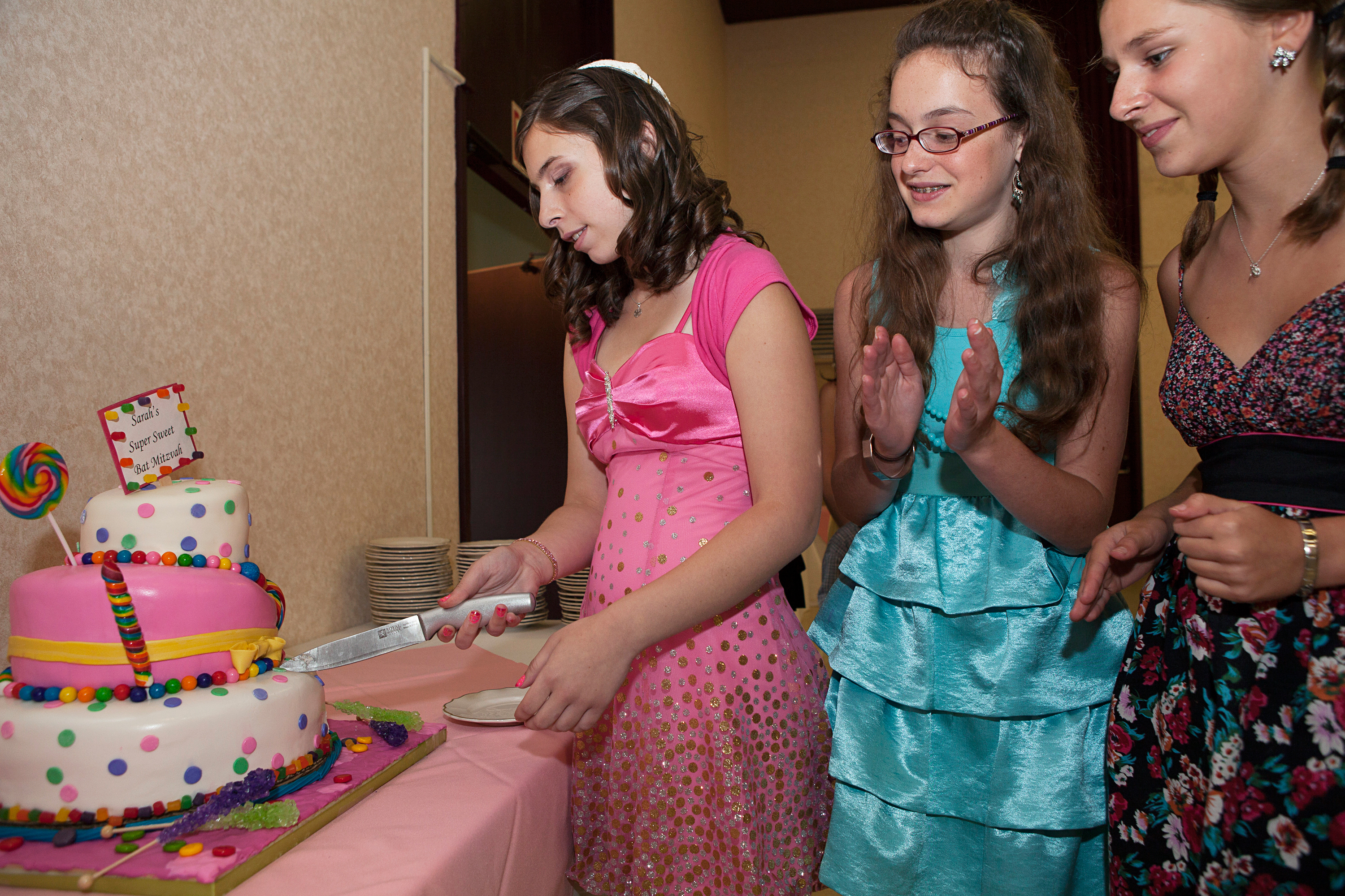 "<strong>According to industry estimates, ""the average bar or bat mitzvah budget runs roughly $15,000 to $30,000,"" writes <a href=""http://www.emitz.com/budget"" title=""eMitz.com: the Bar Bat Mitzvah Planning, Ideas, Vendor Reviews and Invitations Site"" target=""_blank"">eMitz.com</a>, the Bar and Bat Mitzvah Planning site. ""Many variables come into play, such as: time of year, time of day, number of guests and the region.  Manhattan and LA are the priciest.""</strong>                                                                      Title: ""Sarah's Bat Mitzvah, Buffalo, NY,"" from the series <a href=""http://www.rebeccagreenfield.com/#a=0&amp;at=0&amp;mi=2&amp;pt=1&amp;pi=10000&amp;s=0&amp;p=4"" title=""Coming of Age"" target=""_blank""><em>Coming of Age.</em></a>                                                                      <a href=""http://www.rebeccagreenfield.com/"" title=""Rebecca Greenfield"" target=""_blank"">Rebecca Greenfield</a> has been documenting contemporary American female rites of passage for the past six years, photographing coming of age traditions such as Quinceañeras, Bat Mitzvahs, Debutante Balls, Prom, Homecoming, Sweet Sixteen, Purity Balls, Sorority Rush, Apache Sunrise Dances and more. She looks forward to publishing the project in book form when complete."