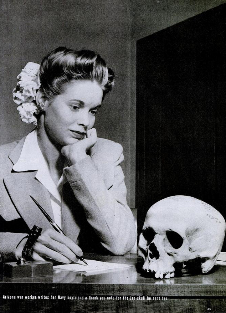 Natalie Nickerson, 20, gazes at a skull — reportedly of a Japanese soldier — sent to her from New Guinea by her boyfriend serving in the Pacific. (May 22, 1944 issues of LIFE, p. 35).
