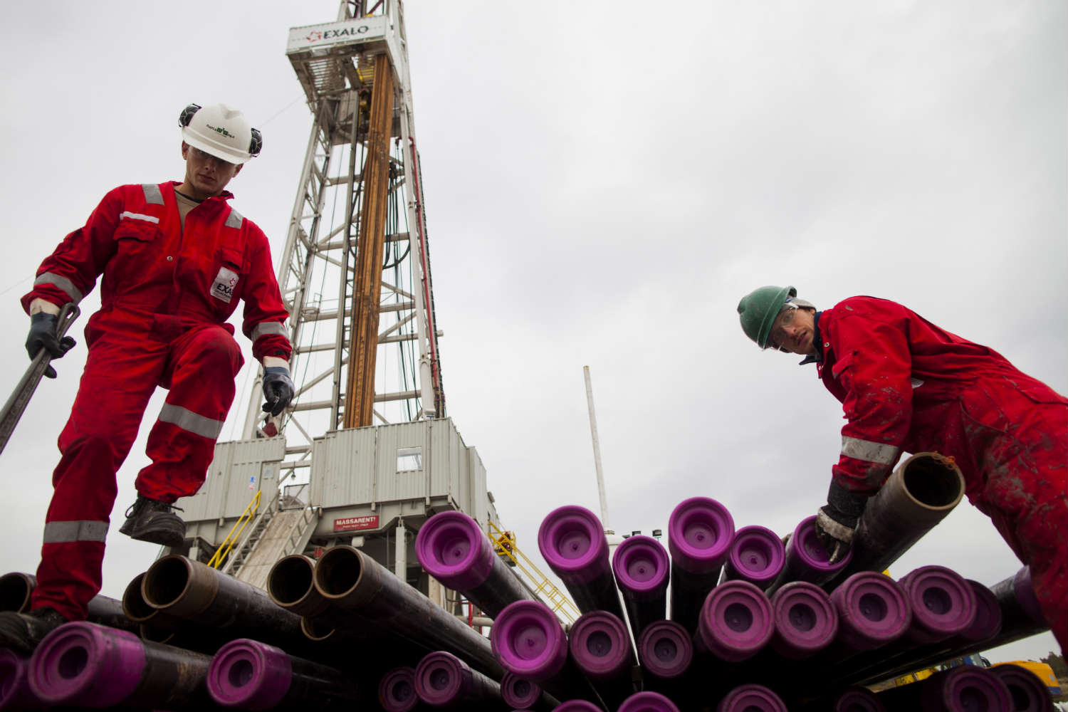 Workers in Poland prepare a shale gas well