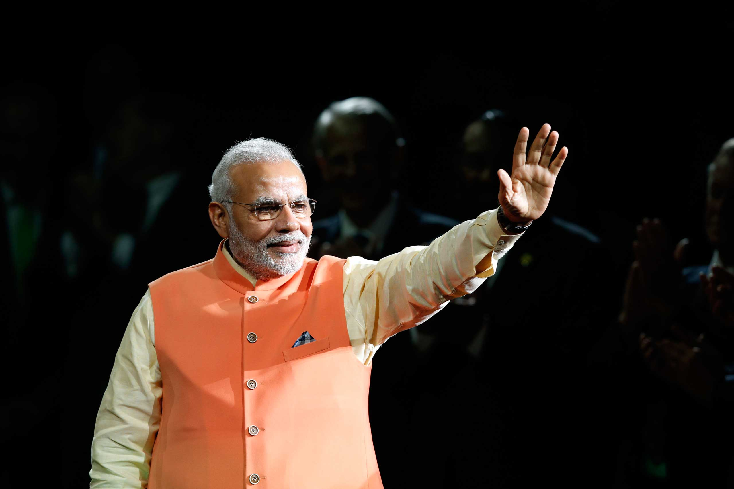 Prime Minister Narendra Modi of India waves to the crowd as he arrives to give a speech during a reception by the Indian community in honor of his visit to the United States at Madison Square Garden, Sept. 28, 2014, in New York.
