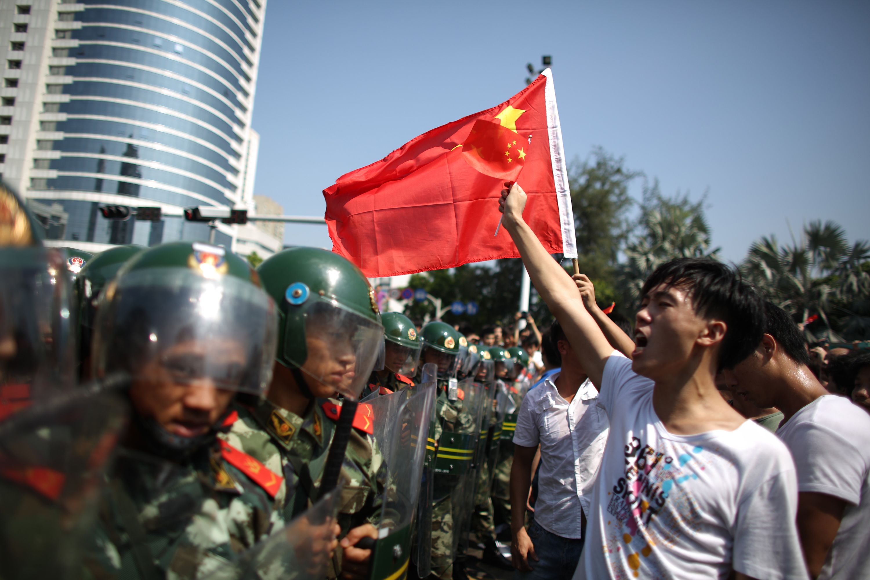 Anti-Japan protesters are confronted by police as they demonstrate over the disputed Diaoyu/Senkaku Islands on Sept. 16, 2012, in Shenzhen