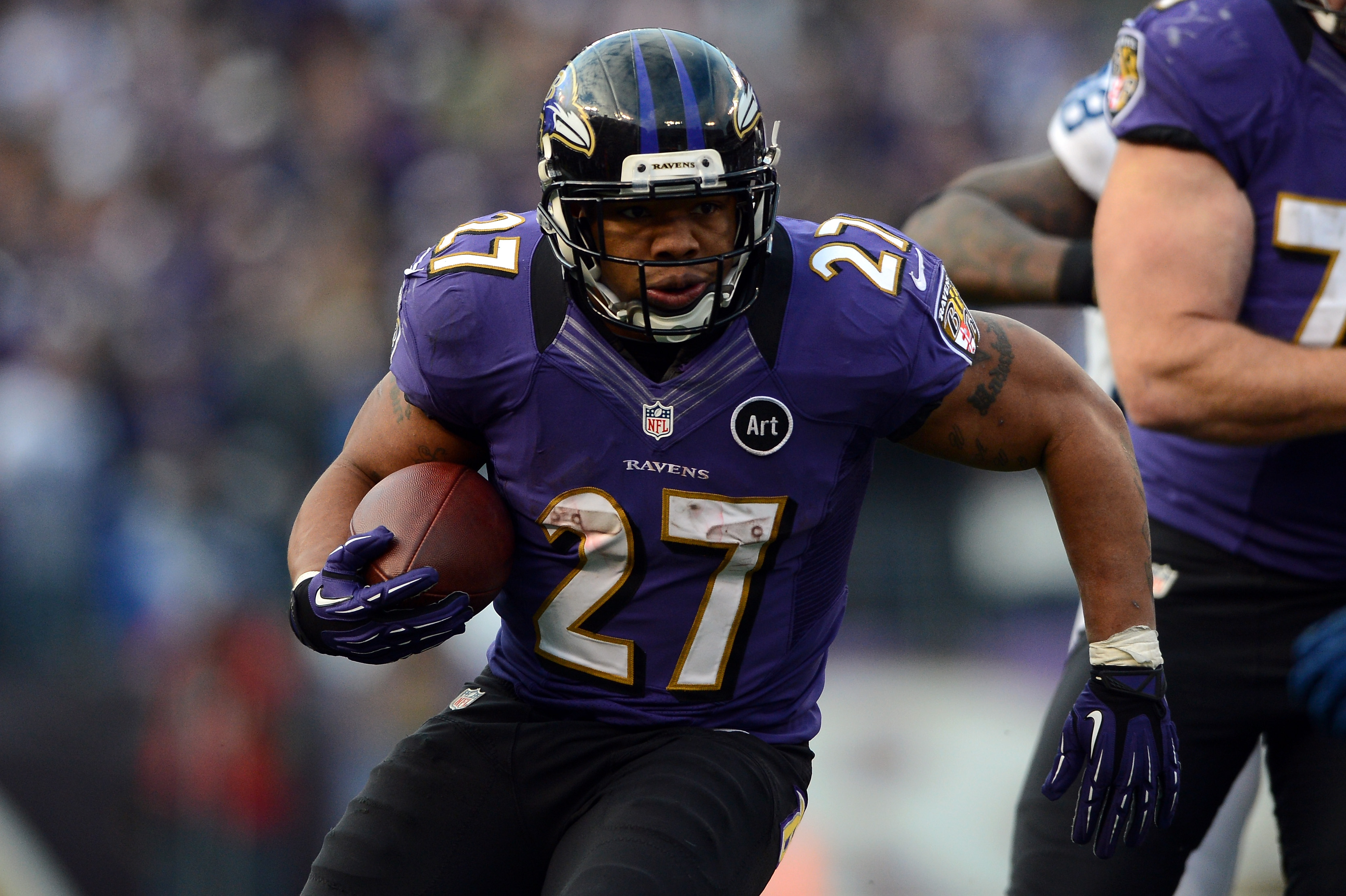 Ray Rice #27 of the Baltimore Ravens runs the ball during the AFC Wild Card Playoff Game on January 6, 2013 in Baltimore, Maryland.