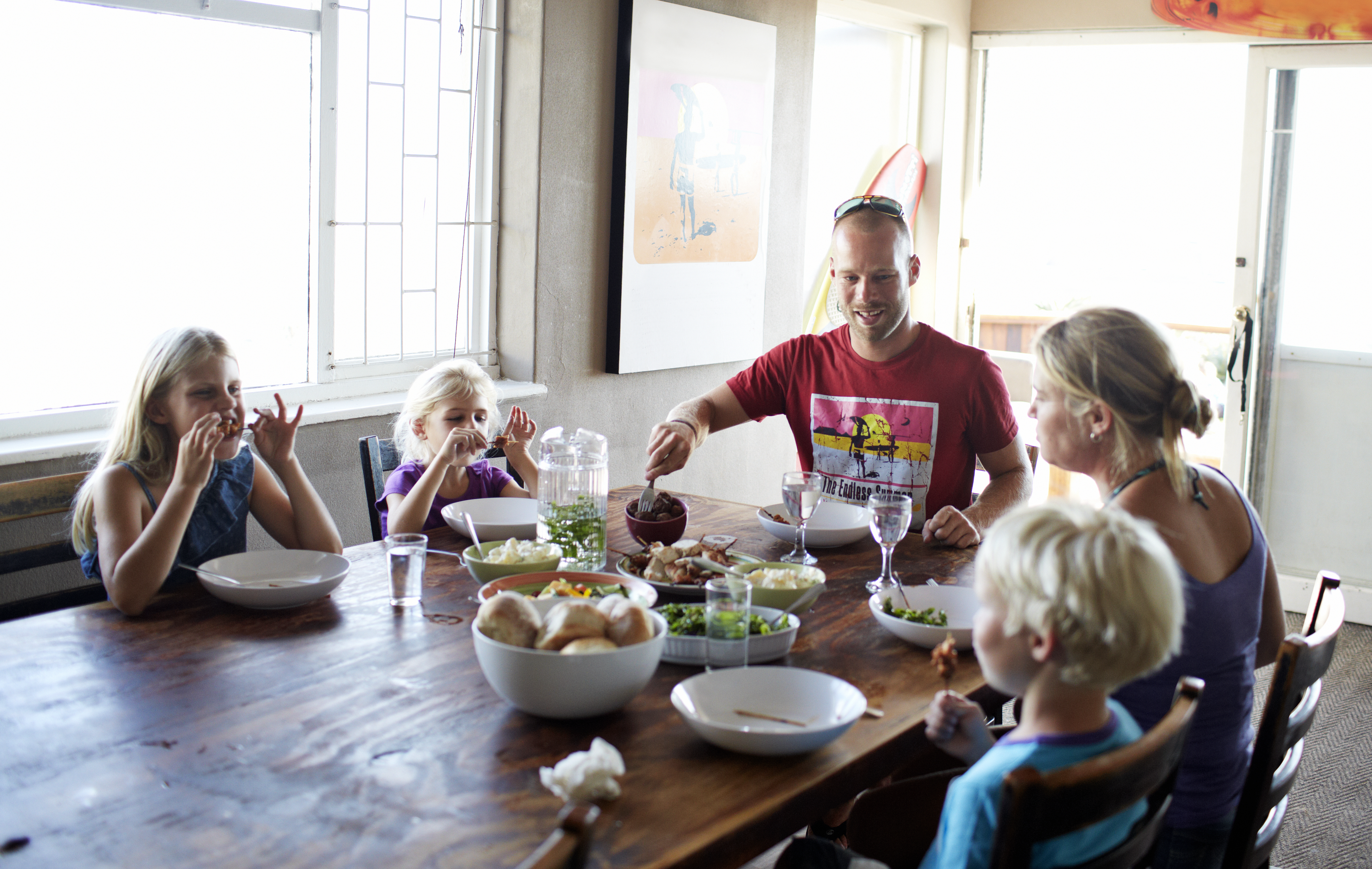 Happy family dinner images like this may be doing more harm than good for working families