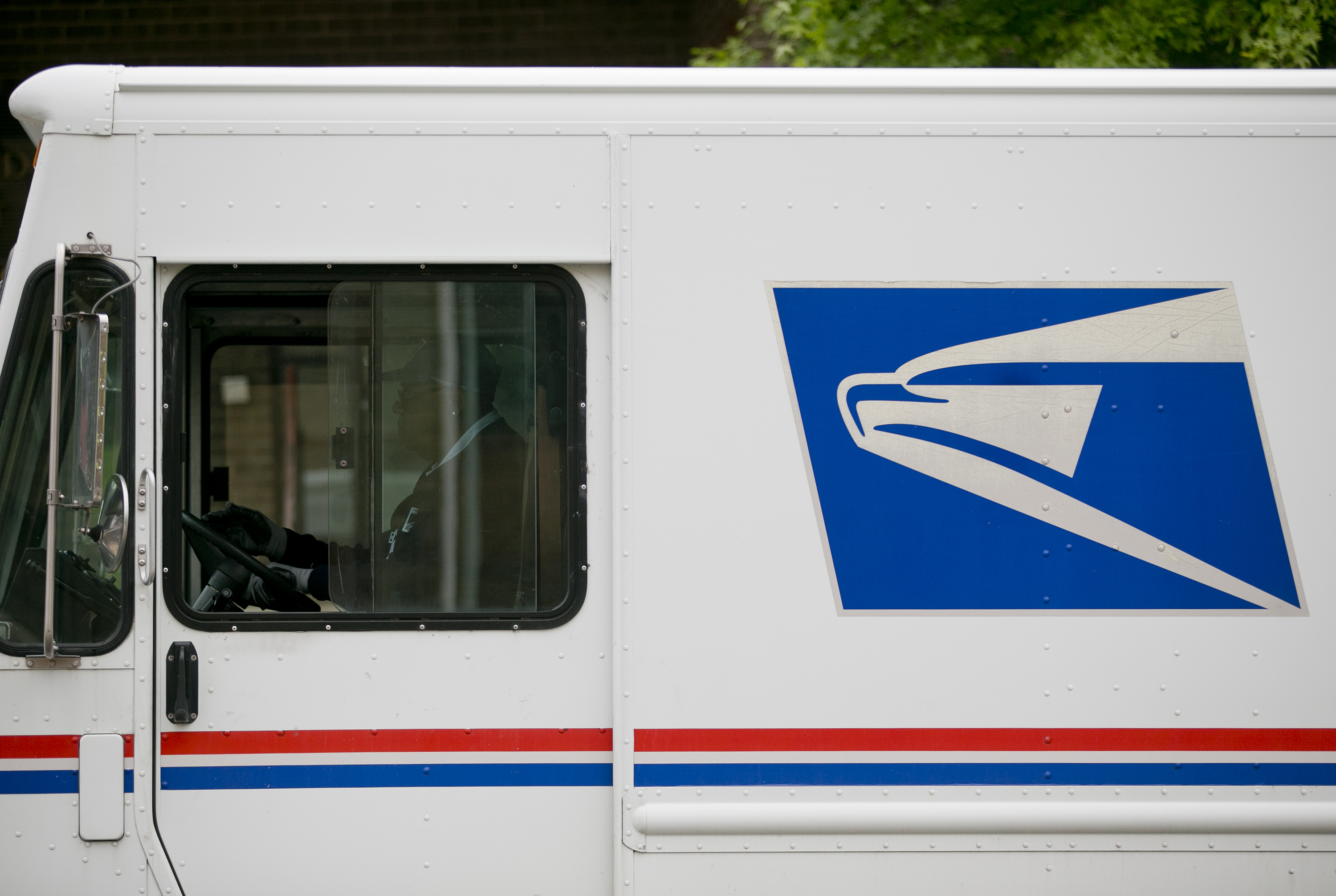 The U.S. Postal Service (USPS) logo is seen on the side of a delivery truck in Washington, D.C., U.S., on Thursday, May 9, 2013.