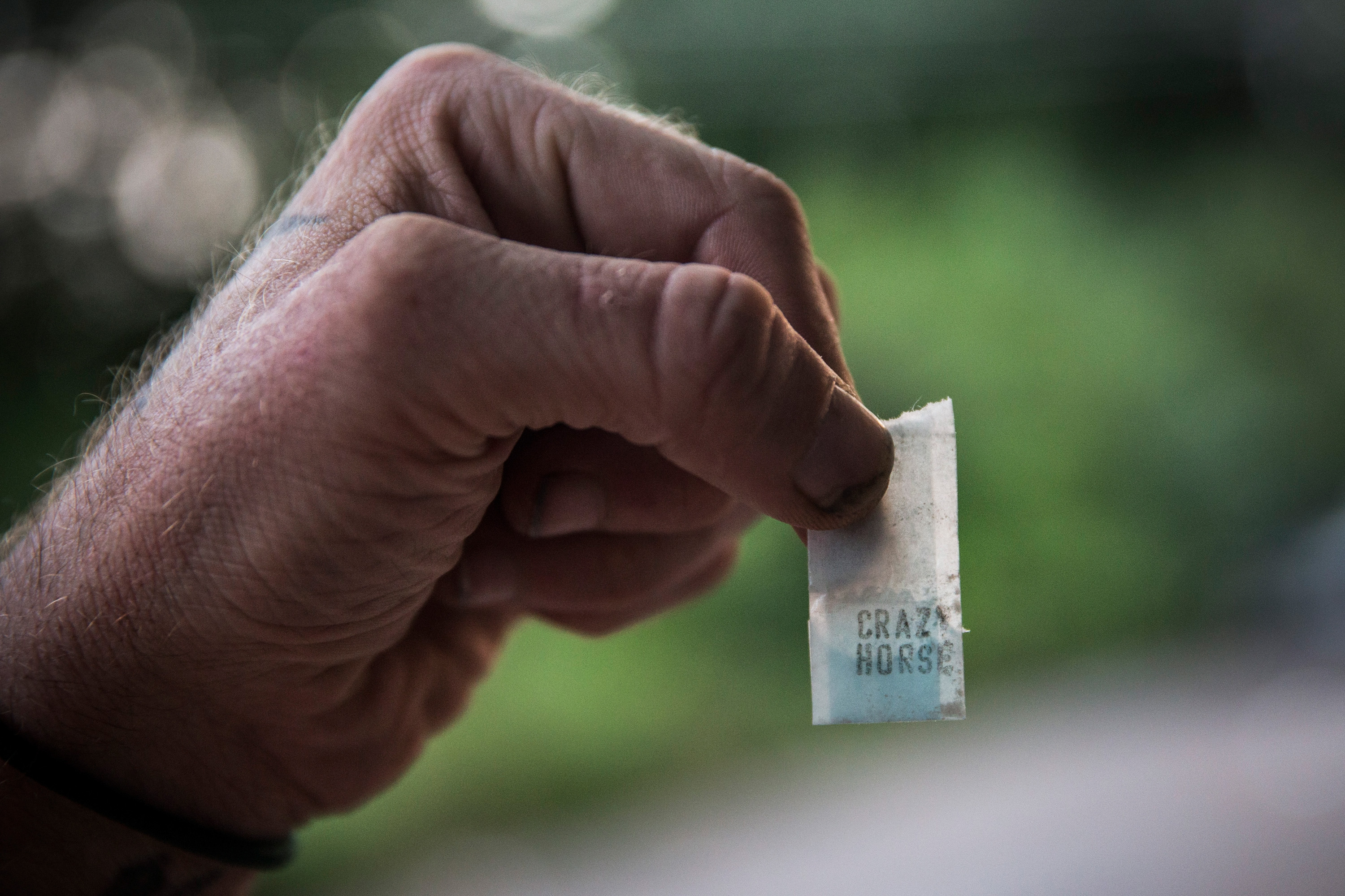 Reggy Colby, age 30 and a recovering heroin addict,  displays a bag heroin is sold in, on August 21, 2013 in Camden, New Jersey.