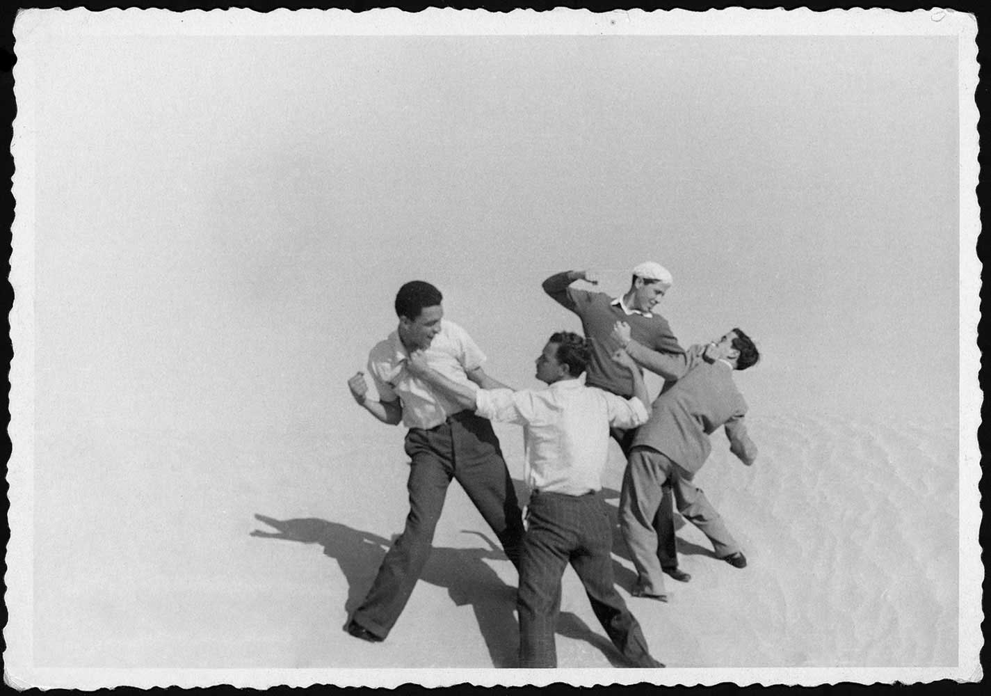 In the desert south of Tripoli, Mohamed Nga, far left, play-fights with friends