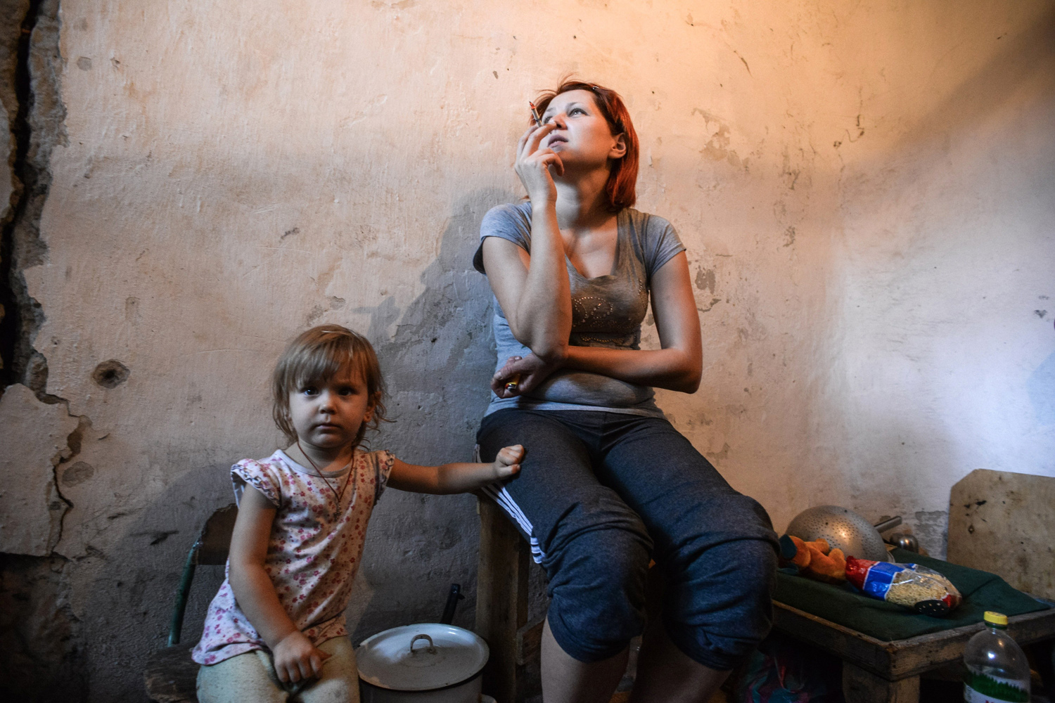 Sept. 1, 2014. A mother and child hide in a bomb shelter in Petrovskiy district in Donetsk, eastern Ukraine. The Petrovskiy district of Donetsk is currently a frontline and one of the districts which suffered the most from the artillery fights between Ukrainian army and Pro-Pussian rebels.