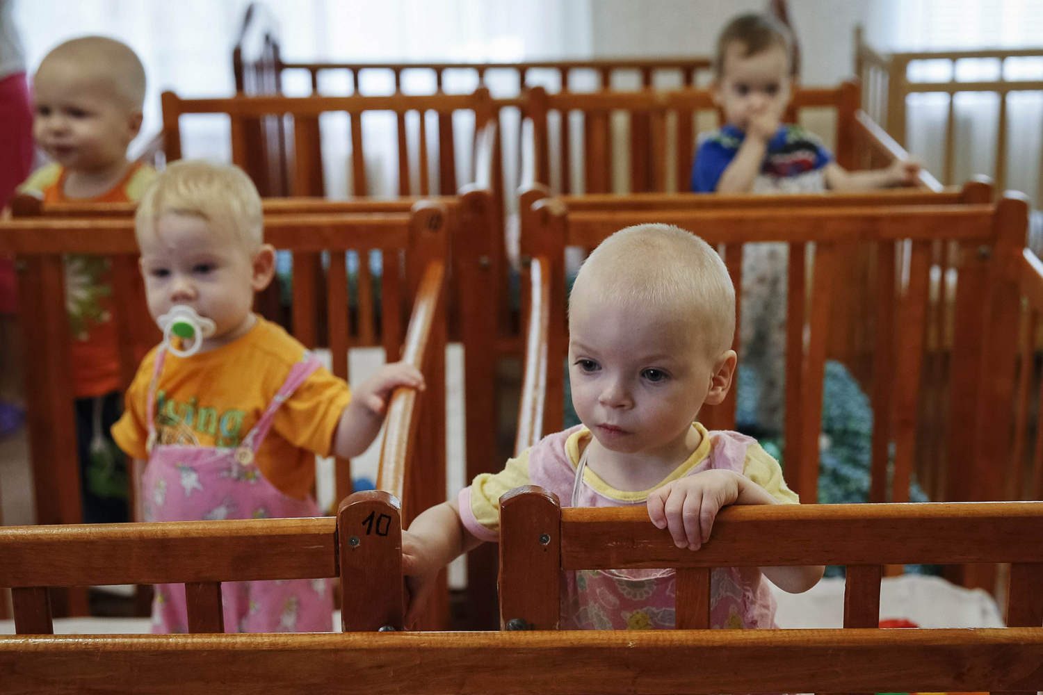 Aug. 30, 2014. Children who were transferred from orphanages in Donetsk and Makeyevka stand in their cribs in an orphanage in Kramatorsk. 76 children from orphanages in Donetsk and Makeyevka in eastern Ukraine were sent to Kramatorsk due to fighting between the Ukrainian army and pro-Russian separatists.