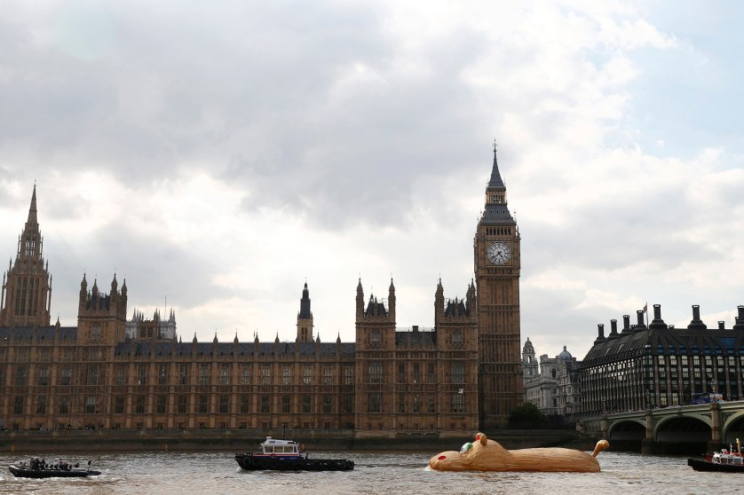 A sculpture of a giant hippopotamus built by artist Florentjin Hofman is towed up the Thames past the Houses of Parliament in central London