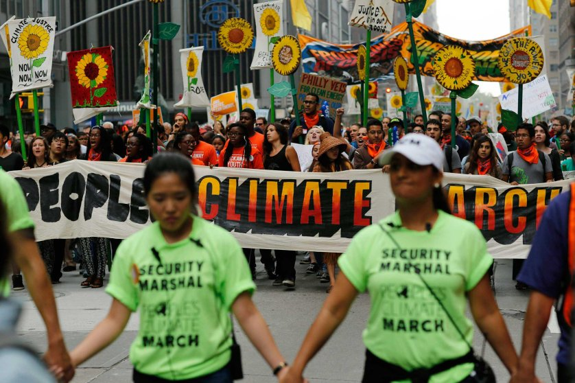 People take part in a march against climate change in New York