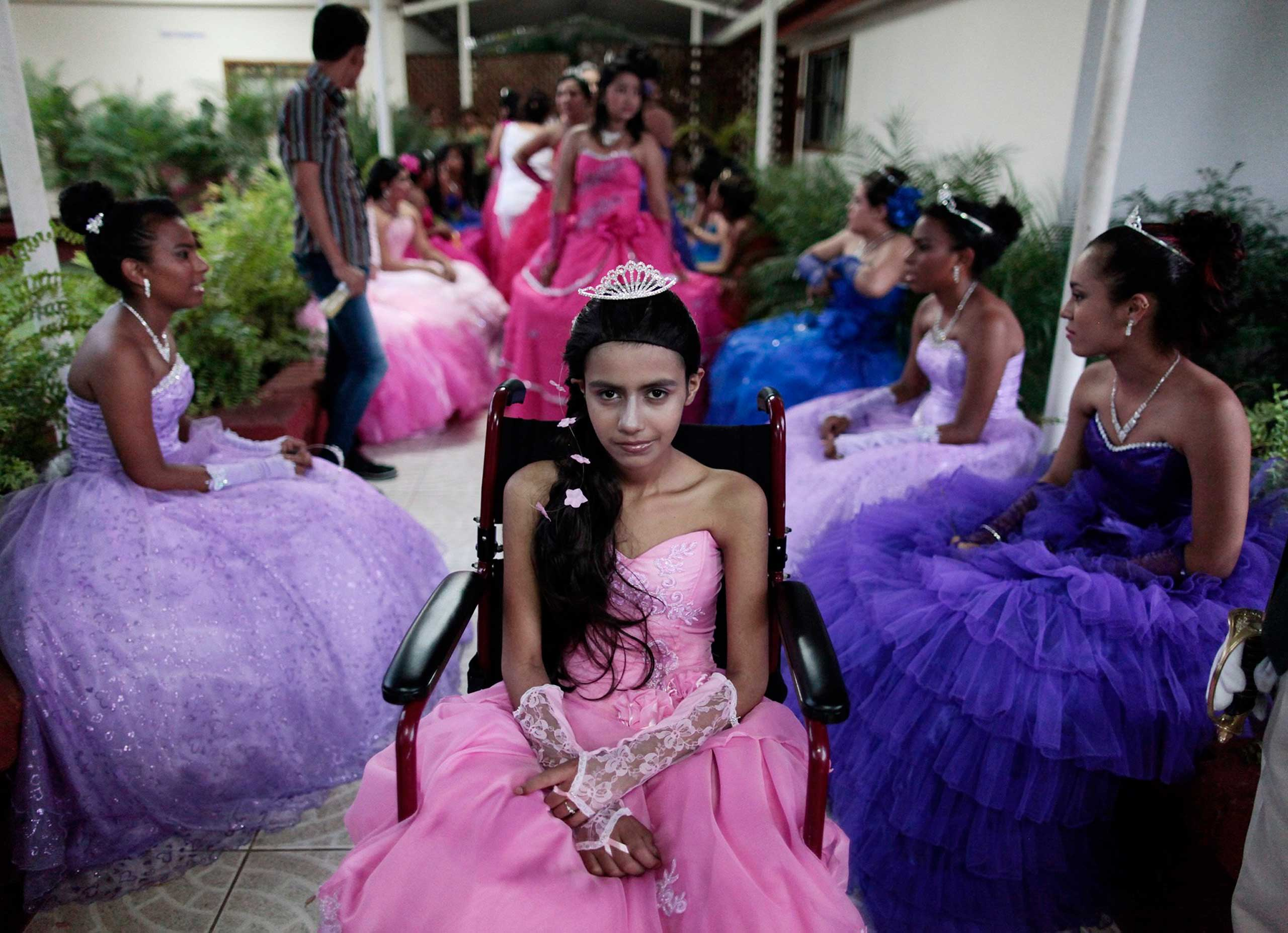 Sept. 20, 2014.A cancer patient poses for a photo during her  Quinceanera  (15th birthday) party among other celebrants at a hotel in Managua, Nicaragua.