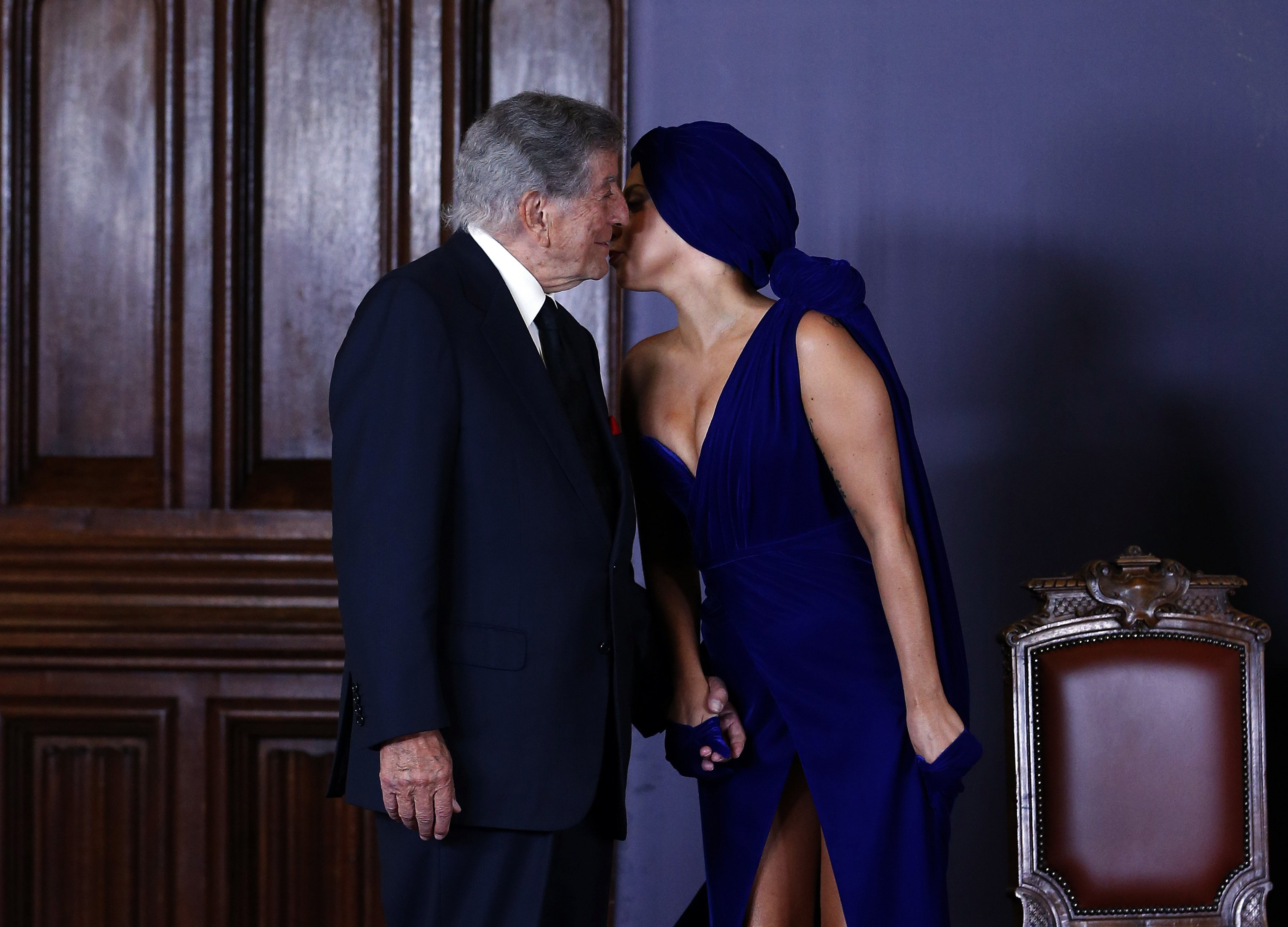 Singers Lady Gaga and Tony Bennett arrive at a news conference, ahead of their concert, in Brussels on Sept. 22, 2014.