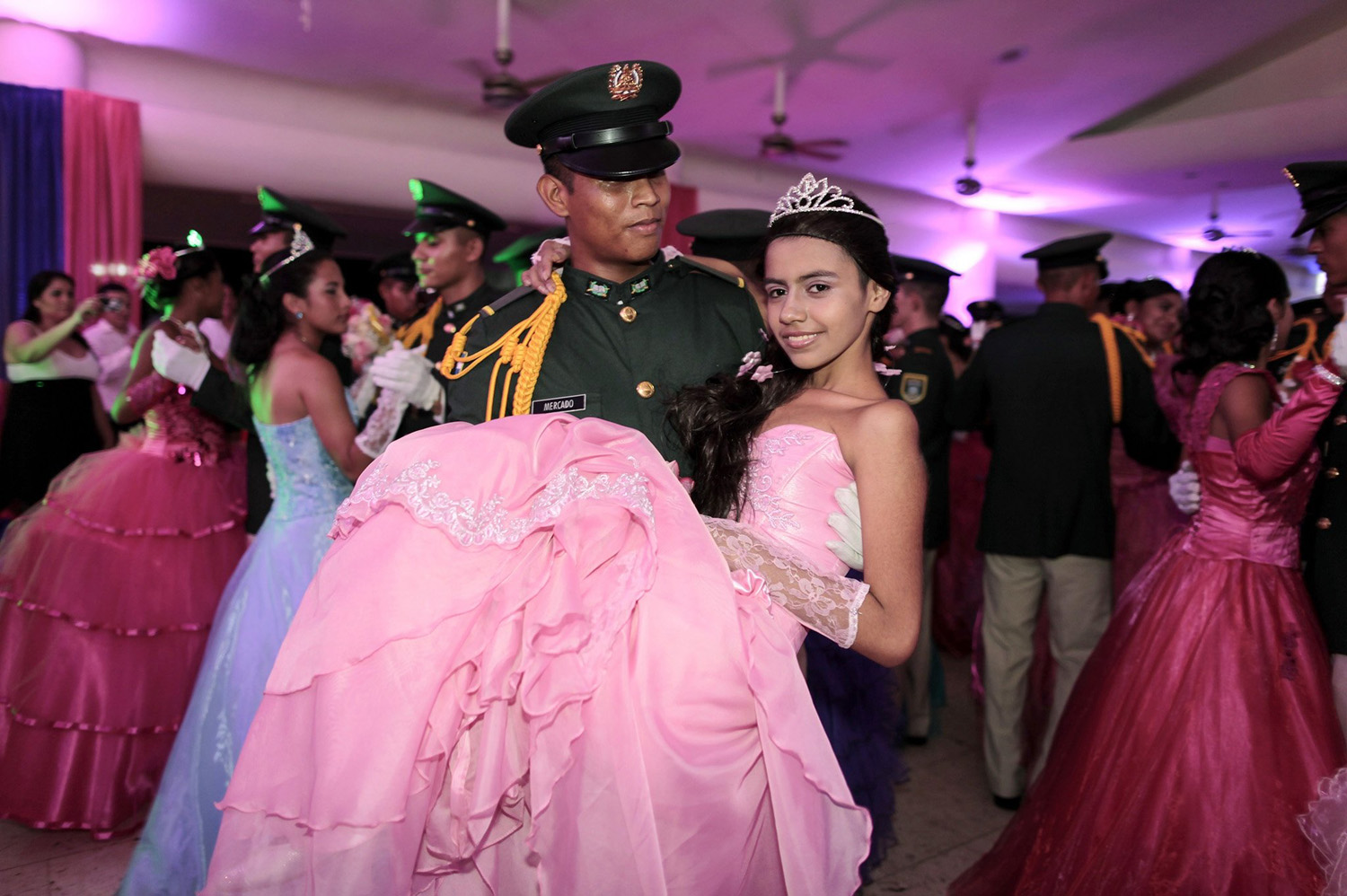 A cancer patient dances with a cadet from Nicaragua's Military Academy during her  Quinceañera  (15th birthday) party at a hotel in Managua, Nicaragua on Sept. 20, 2014.