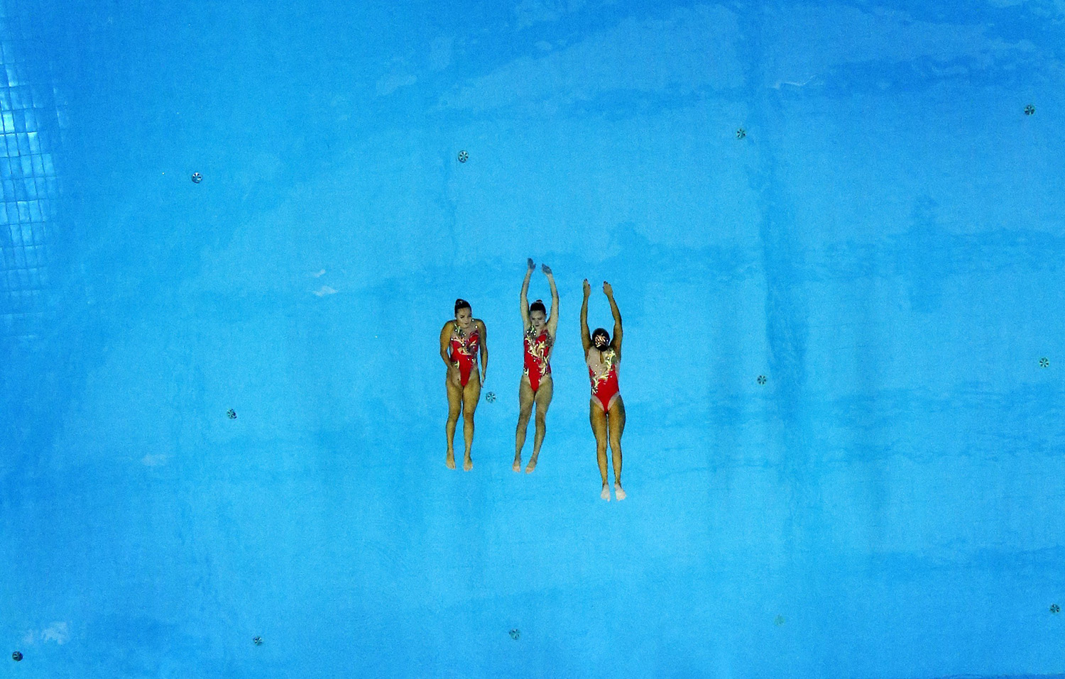 Three members of the bronze medal winning Kazakhstan team perform during their Synchronised Swimming Free Combination routine at the Munhak Park Tae-hwan Aquatics Center during the 17th Asian Games in Incheon, South Korea on Sept. 23, 2014.