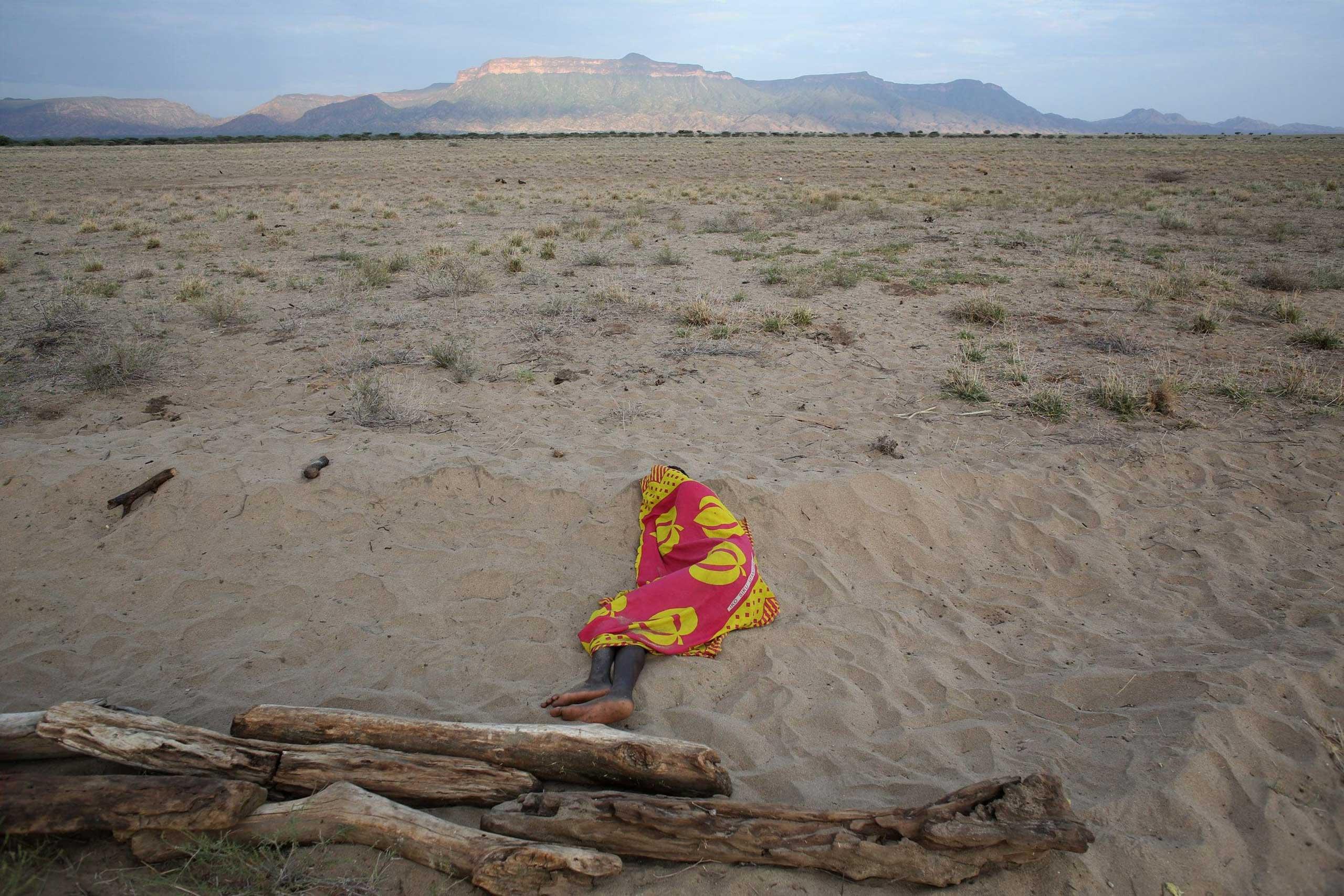 Sept 25, 2014. A Turkana man sleeps on the western shore of Lake Turkana close to Todonyang near the Kenya-Ethiopia border in northern Kenya.