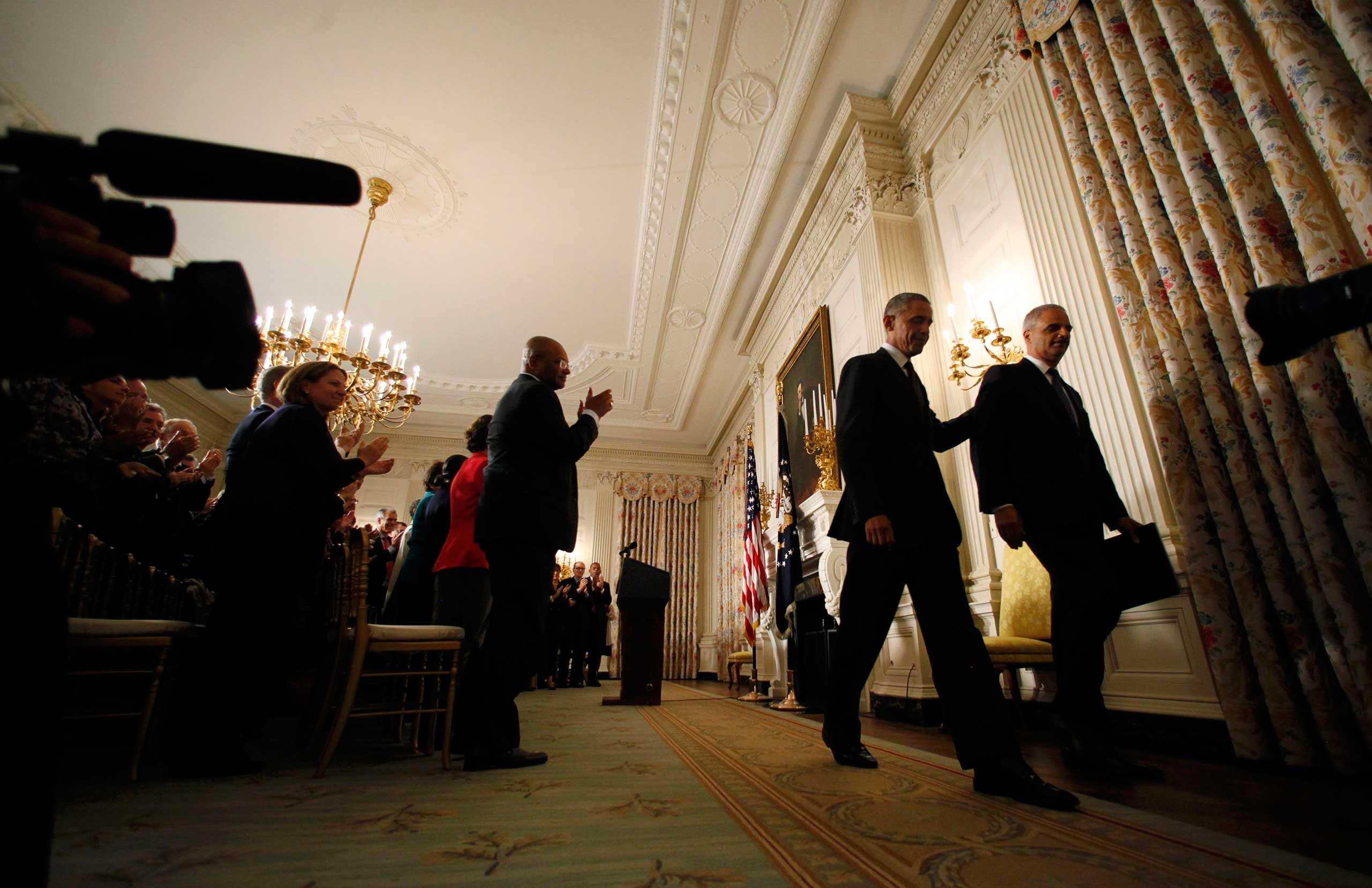 Sept. 25, 2014. President Barack Obama and U.S. Attorney General Eric Holder depart together after announcing Holder's resignation as Attorney General in the White House State Dining Room at the White House in Washington, D.C.