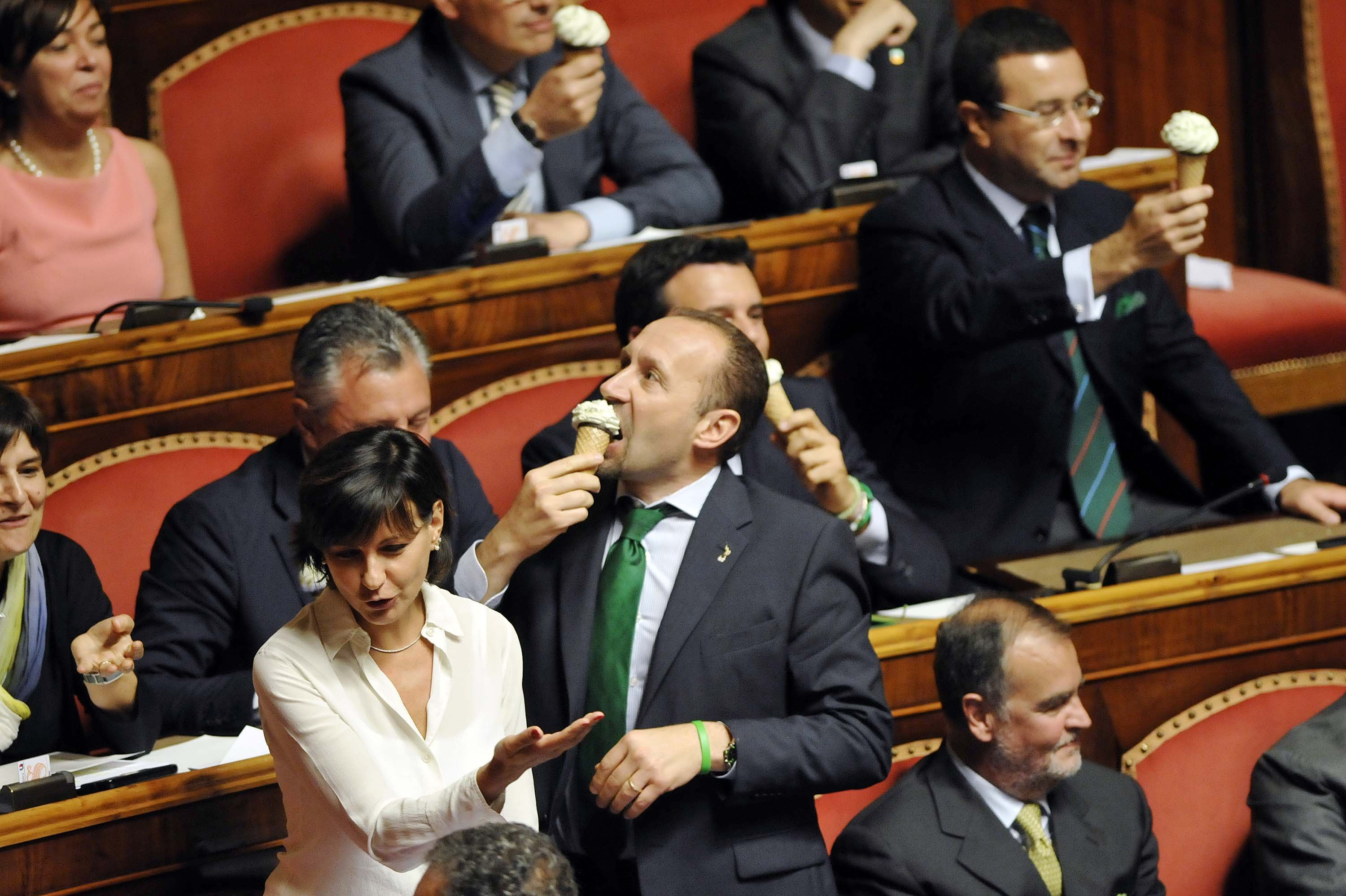 Deputies of Lega eat ice cream in the senate while Prime Minister Matteo Renzi speaks on the implementation of a government program on Sept. 16, 2014 in Rome.