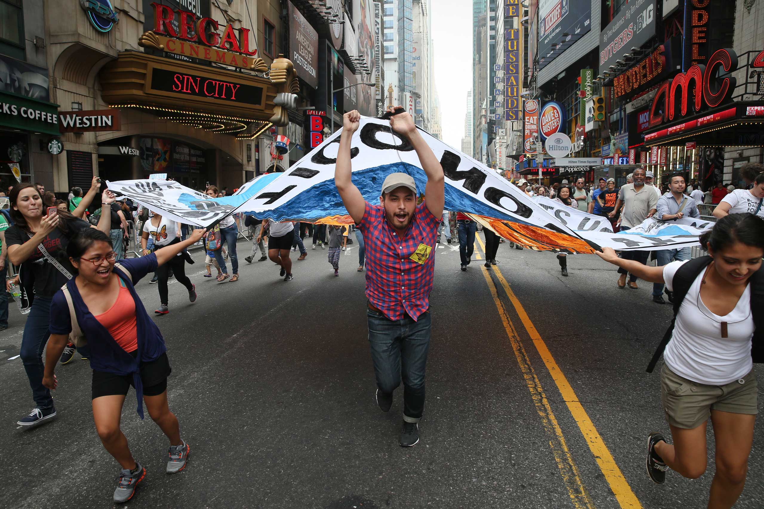 Marchers  carry a banner in midtown Manhattan.