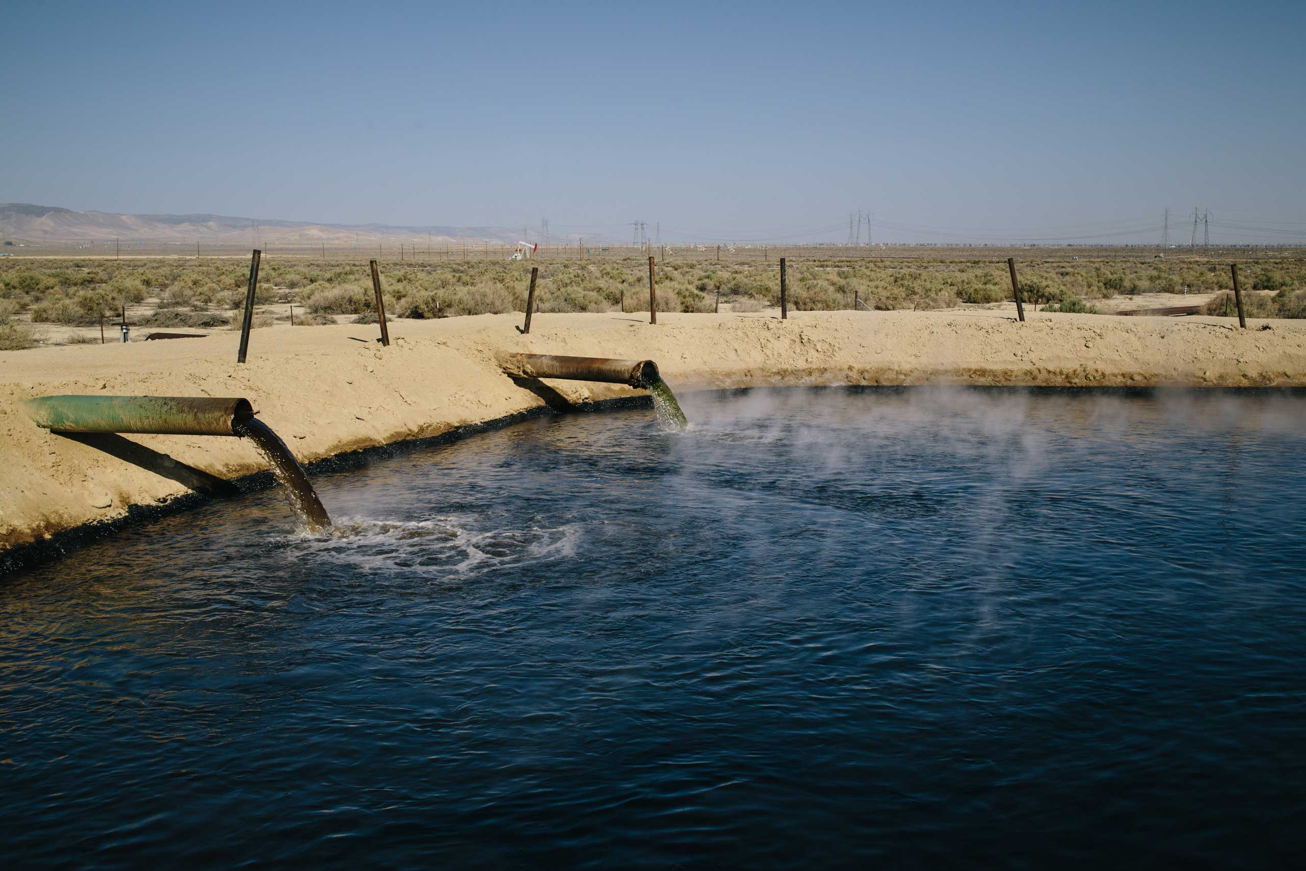 Percolation ponds fill up with runoff water from nearby Belridge Oil Fields in Eastern Kern County. As the water evaporates, leaving oil residue, hydrogen sulfide, methane and volatile organic compounds, or VOCs, are released in to the air.