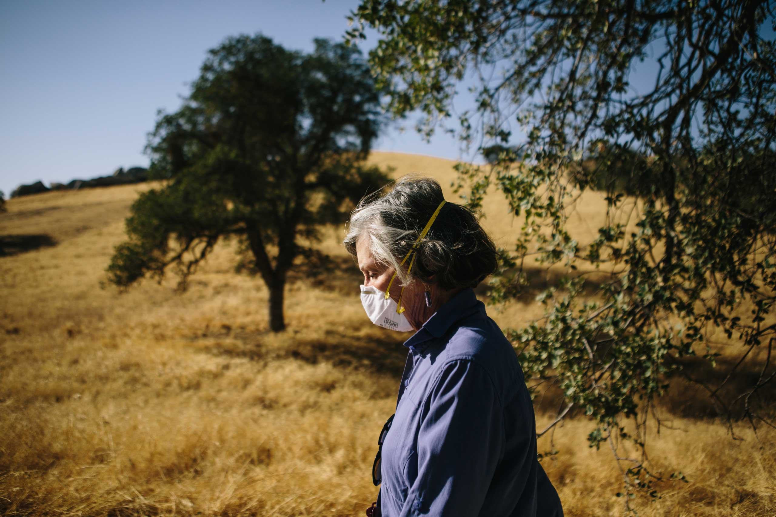 Lucy Clark, 72, lives in the foothills north of Bakersfield. Her home sits at 2200 feet, which is about the elevation where the visible layer of smog begins to hang in the air. Because of this, Clark, who suffers from asthma, wears a mask every day she walks out to get the mail.