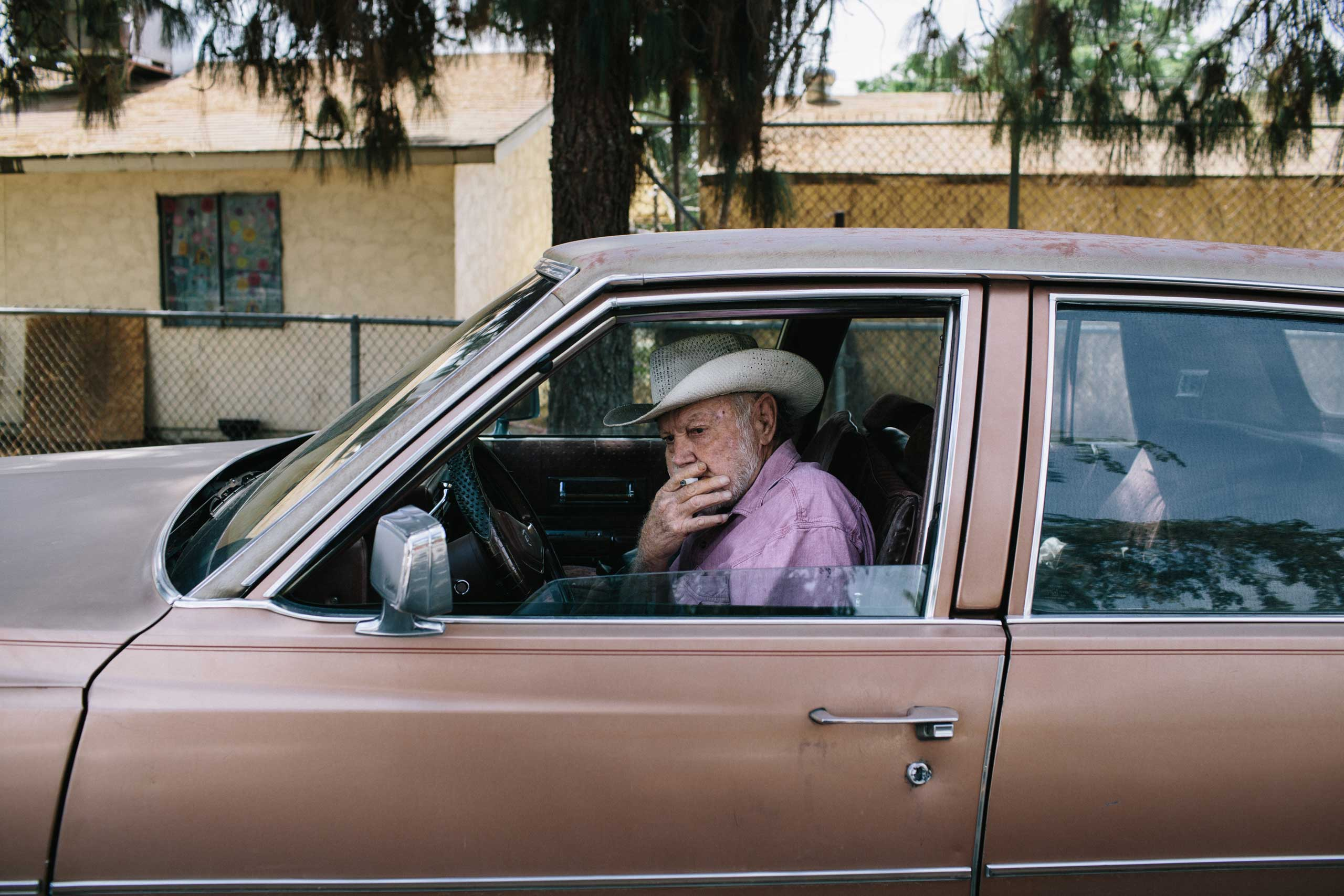 Red Simspon, a country music legend and Bakersfield native, smokes a cigarette outside of the Rasmussen Senior Center in Oildale, north of Bakersfield.