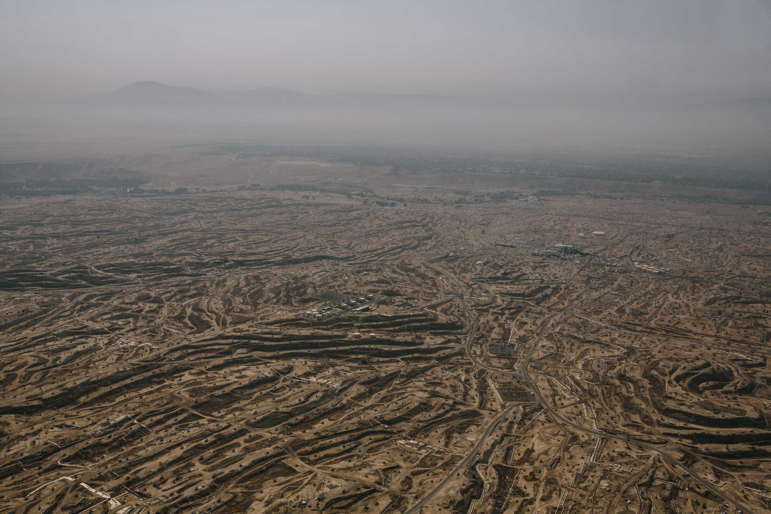 Oil pumps and scarred earth can be seen for miles in an area of North Bakersfield called the Bluffs. A Cogeneration Plant sits in the middle of the fields and is one of California's top polluters.