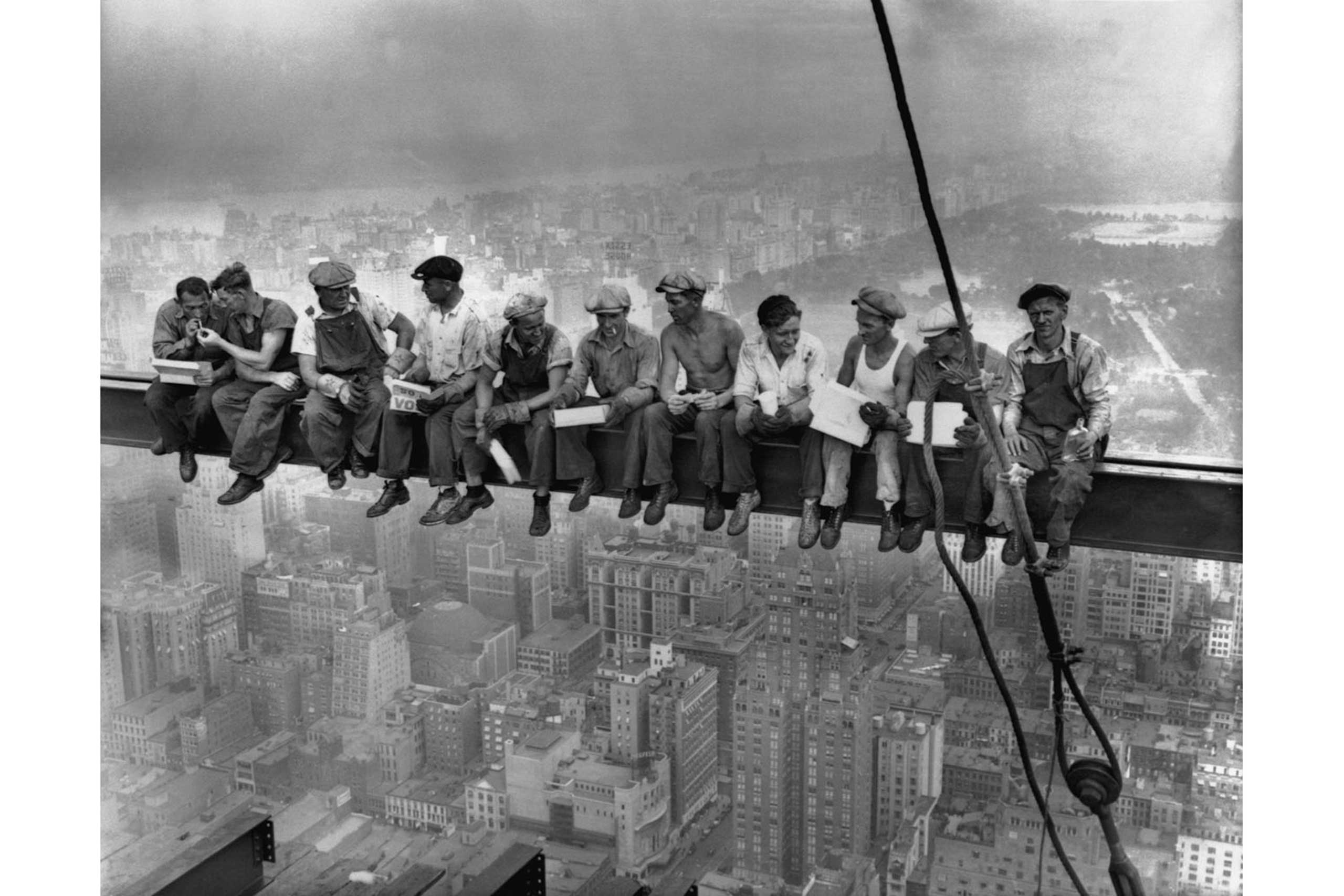 Construction workers eat their lunches atop a steel beam 800 feet above ground, at the building site of the RCA Building in Rockefeller Center in New York, Sept. 29, 1932.
