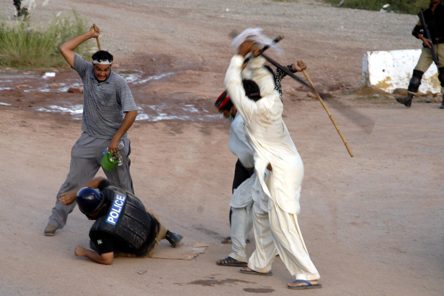 Sept. 1, 2014. Supporters of Imran Khan and Tahir-ul-Qadri, leader of Pakistan Awami Tehreek (PAT), attack Pakistani security forces' during the ongoing anti-government protests in Islamabad, Pakistan.